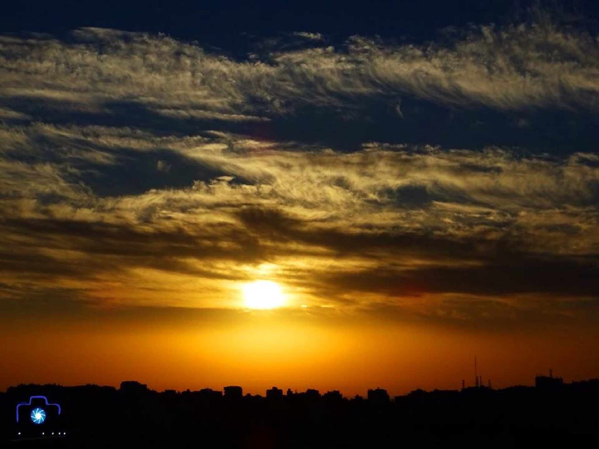 magic sunrise with clouds by Mohammed Muthanna