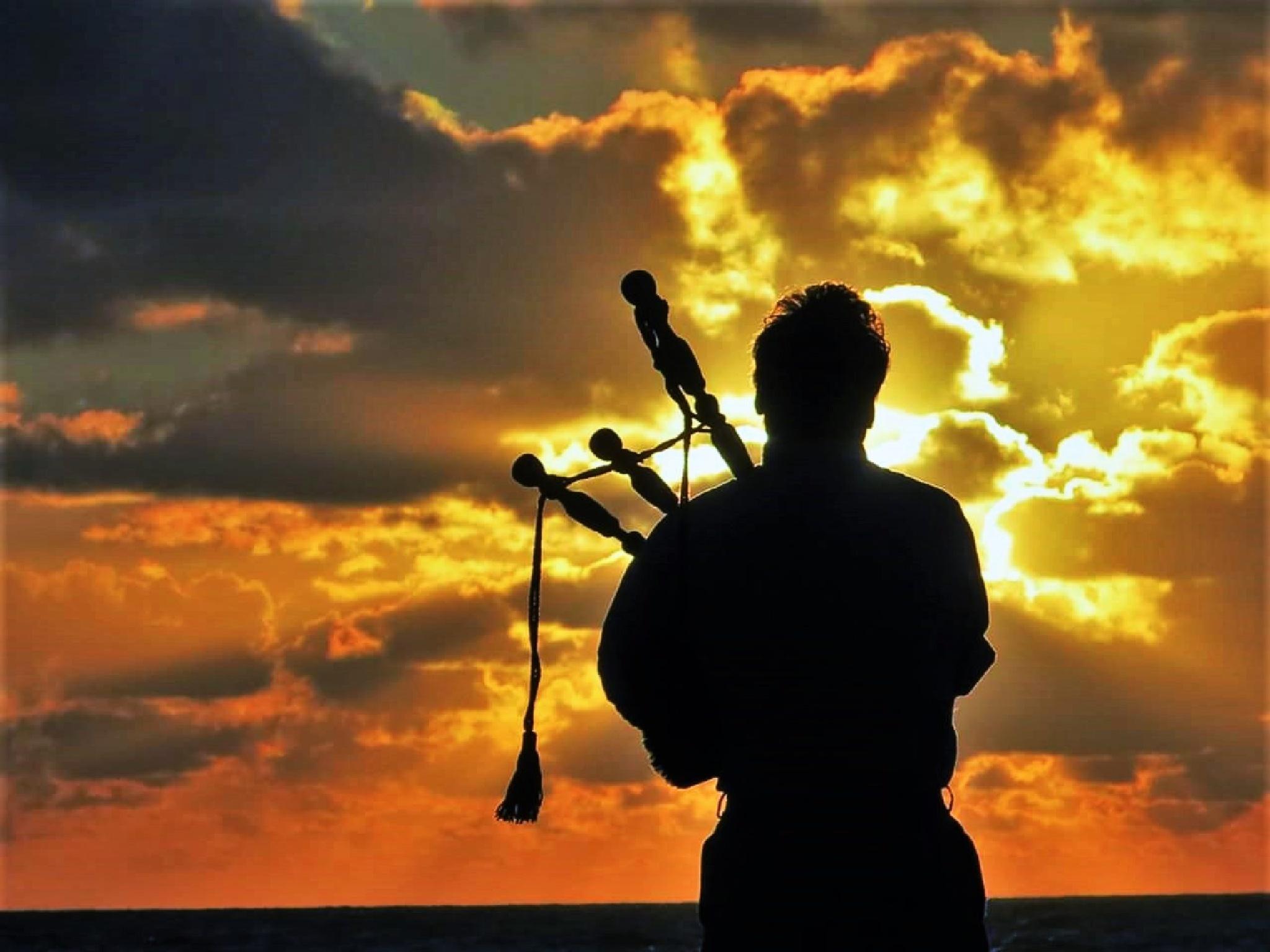 Bagpipes at sunrise by peterjohn