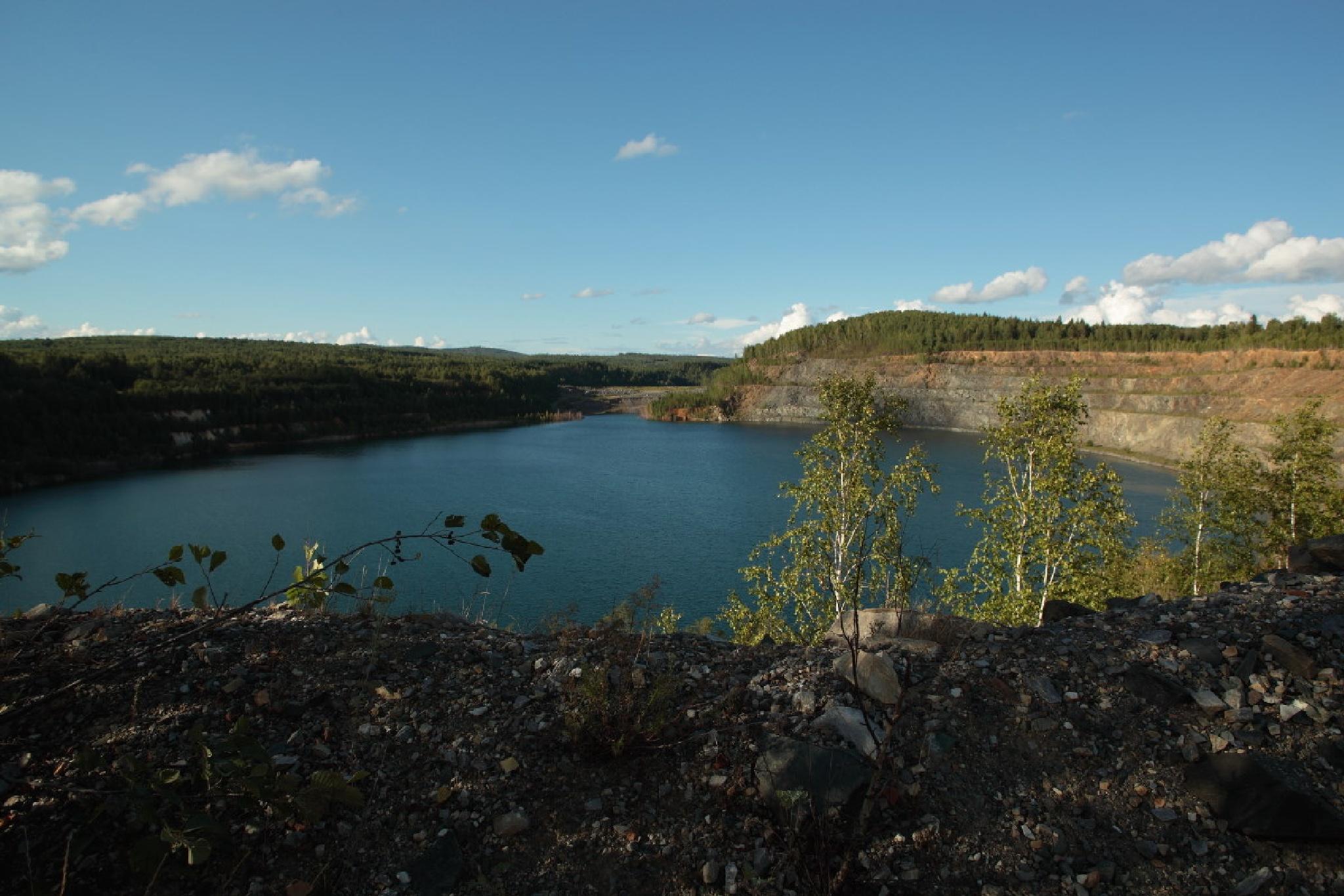 flooded quarry by Alexey Komarov