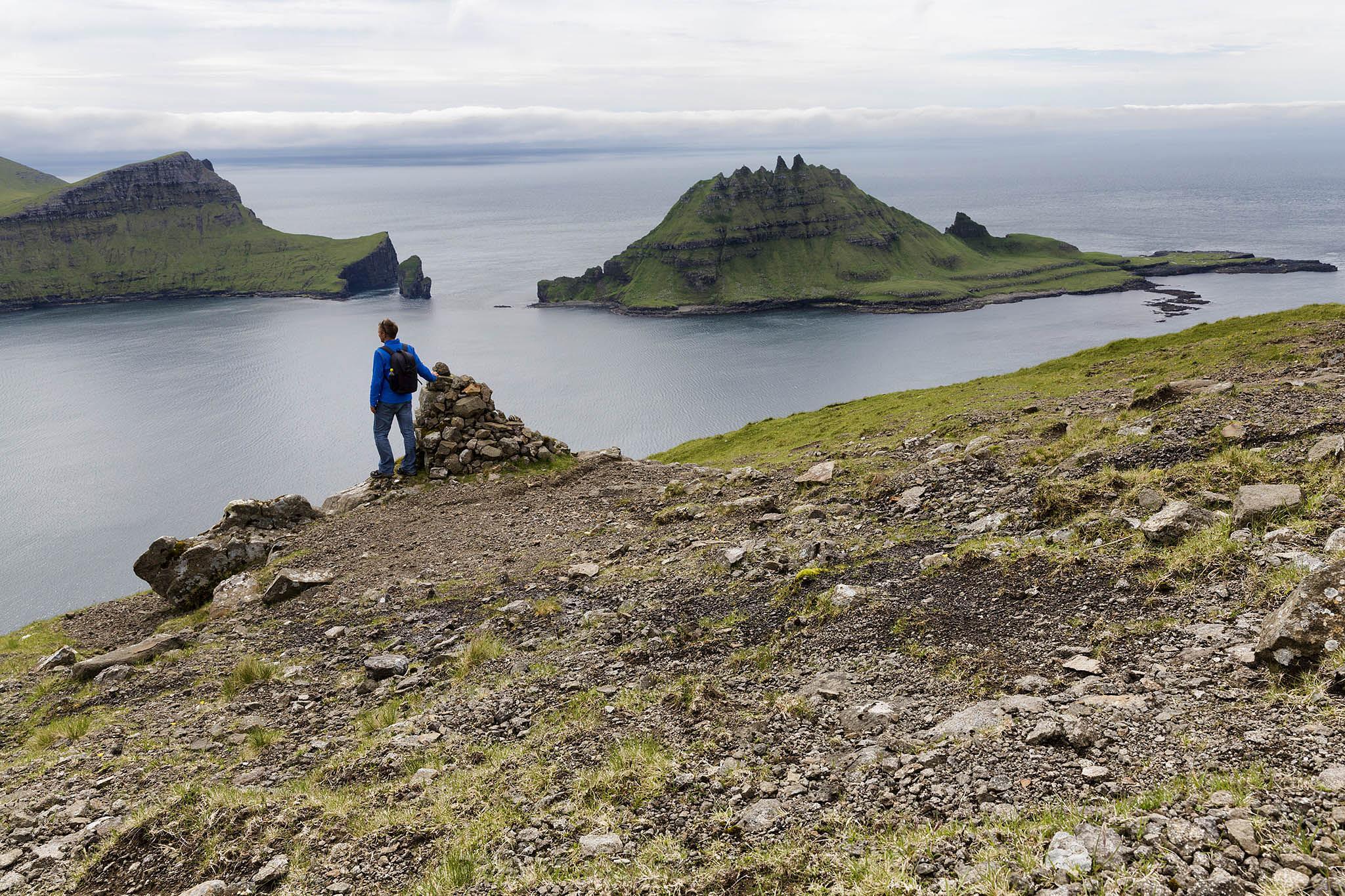 Self portrait  - Me standing looking at Tindholmur by Faroe Islands Hiking
