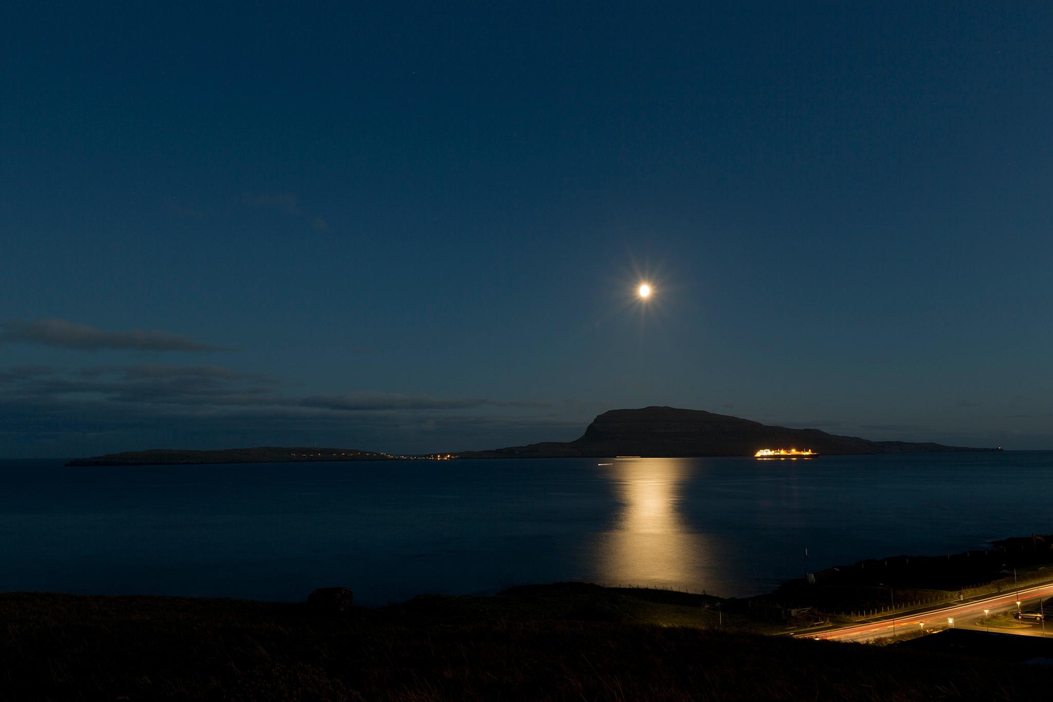 Silent evening in the Atlantic Ocean by Faroe Islands Hiking