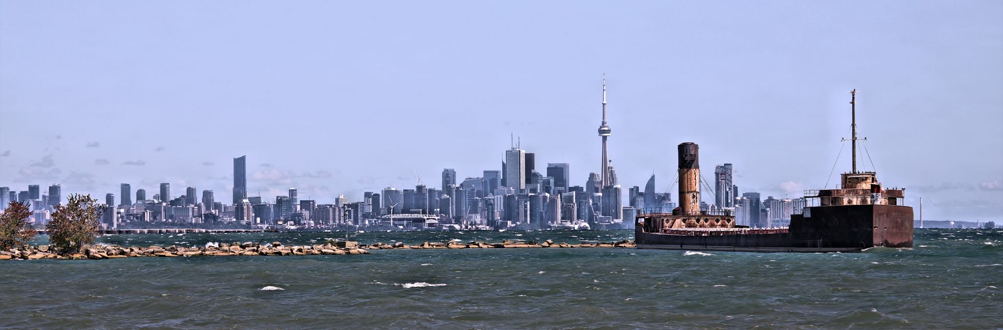 Toronto from Port Credit.. by Roland Lavigne