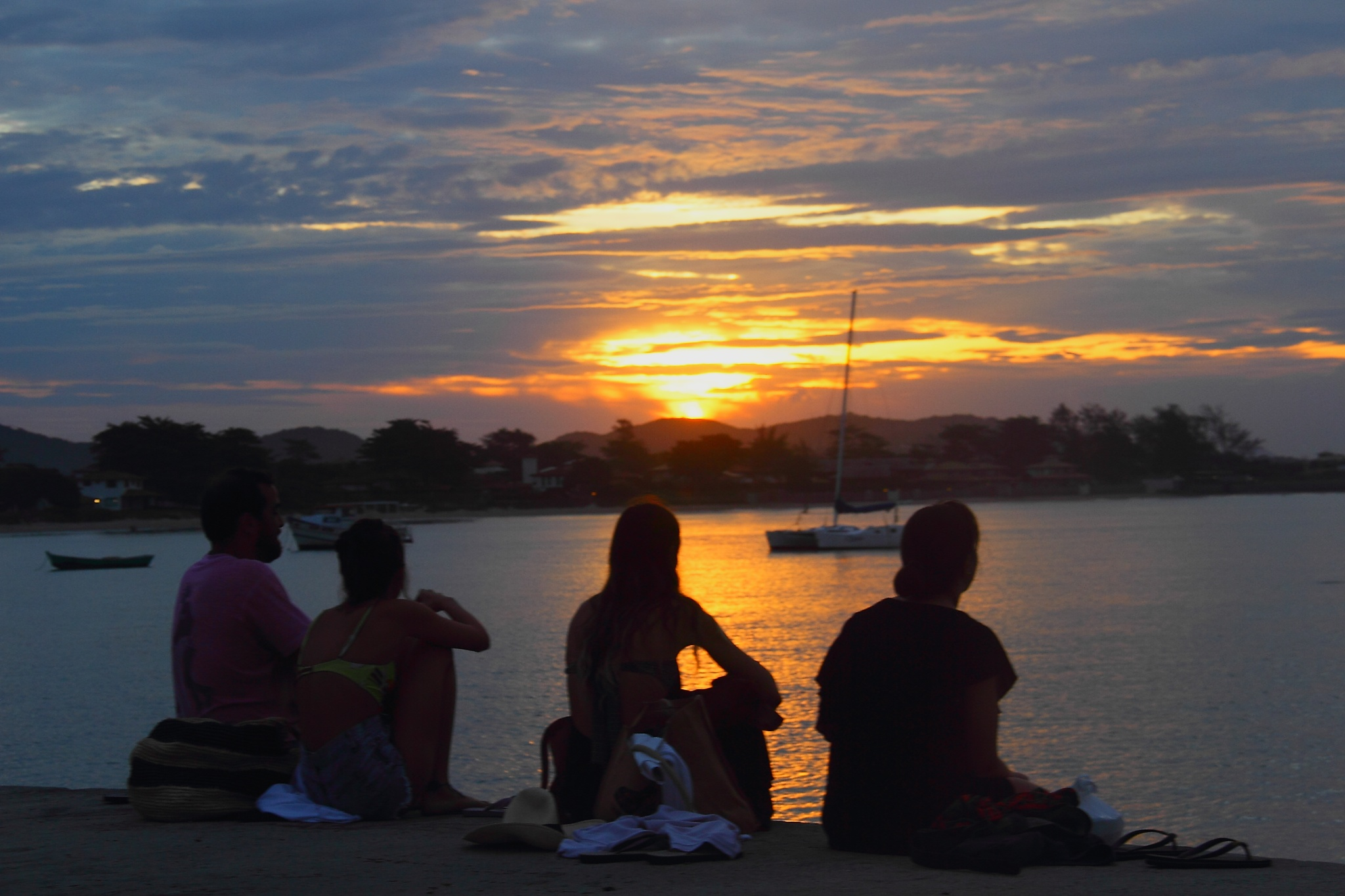 FRIENDS ASSIST THE SUNSET by Ellan Lustosa Photojournalist