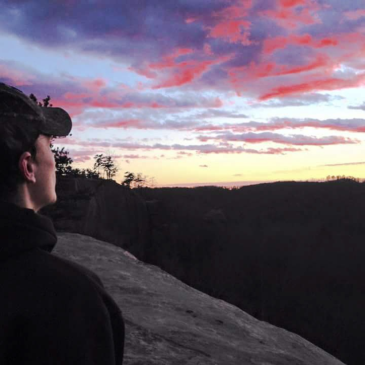 My son amazed at the sky on top of the mountains by Tina Hayes
