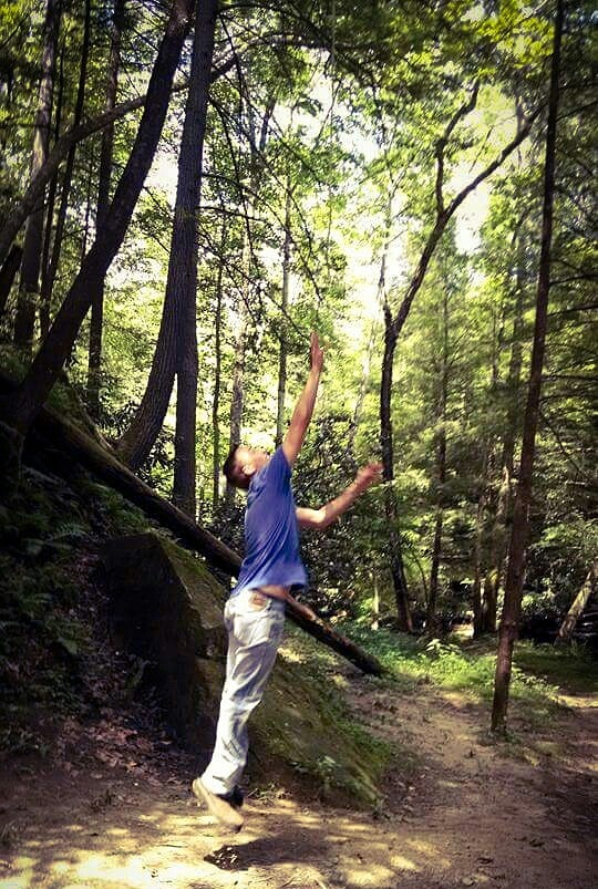My son playing around Swift Creek. He thought he could swing from the vines. by Tina Hayes