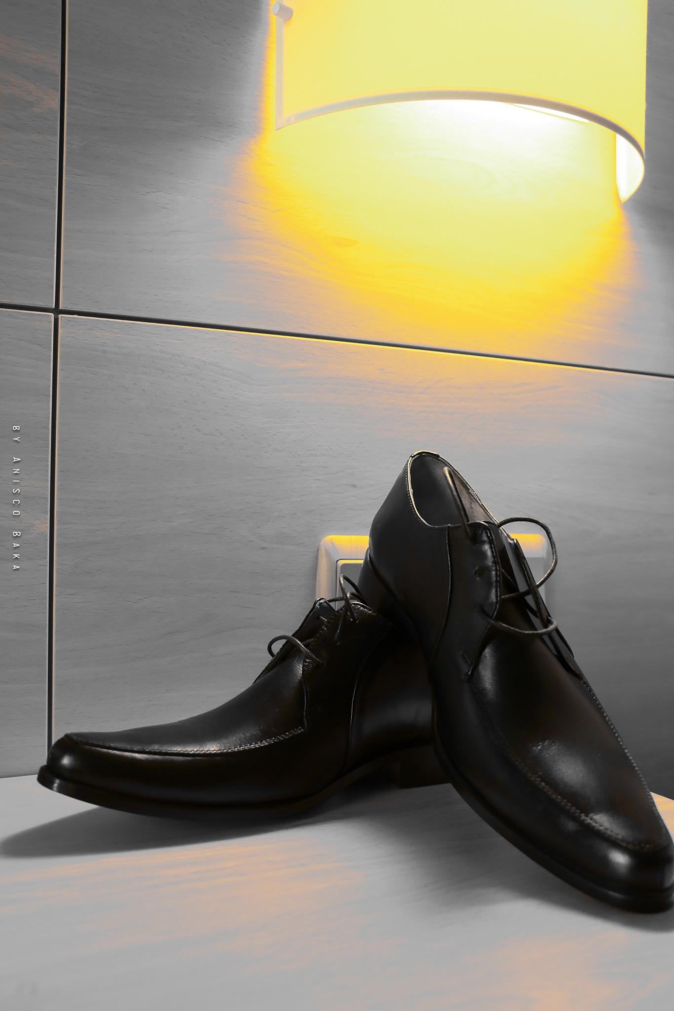 the groom's shoe by Anisco Baka