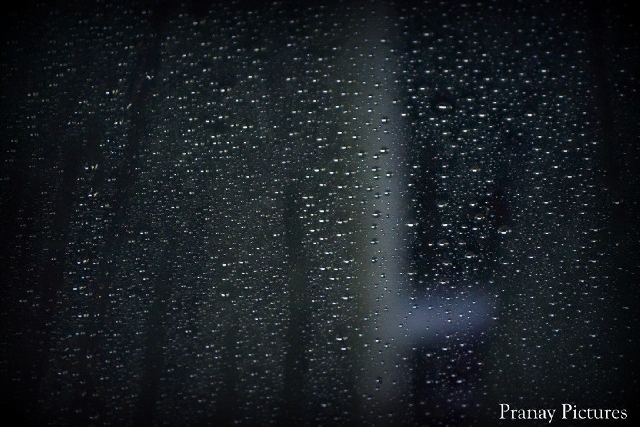 Water drops on a car's Wind Shield  by Pranay Pictures