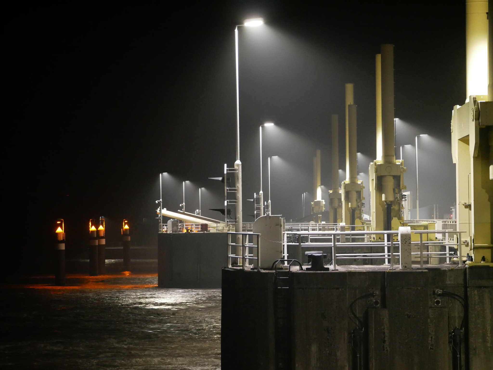 The Gandersum dam in the river Ems by night. by Martha de Vries