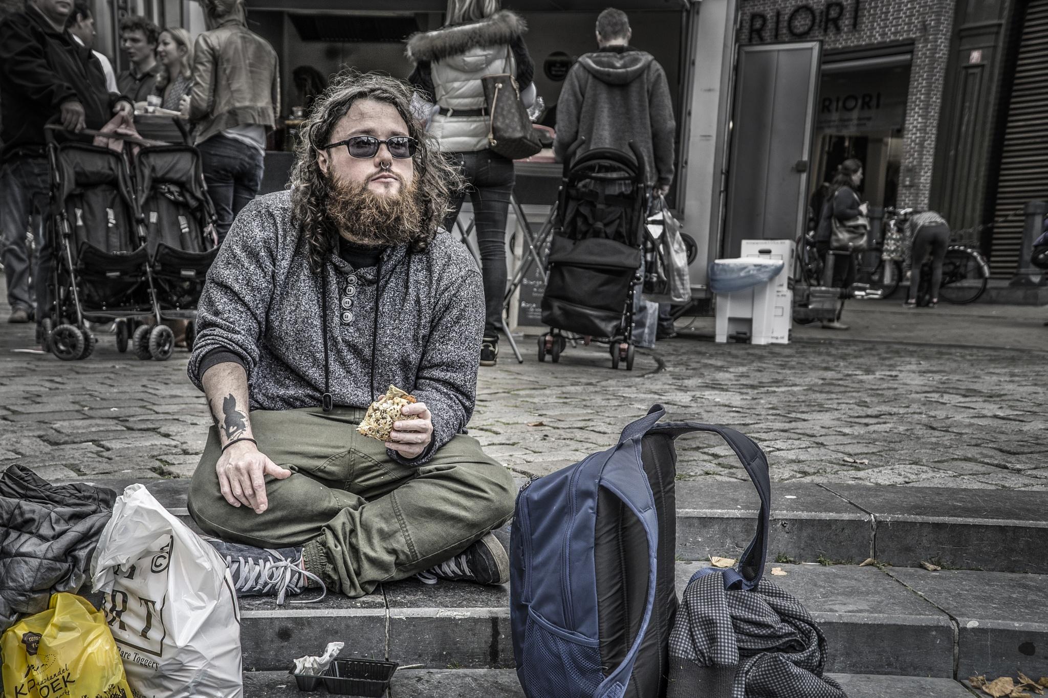 Eating on the street by Joop Nijhof
