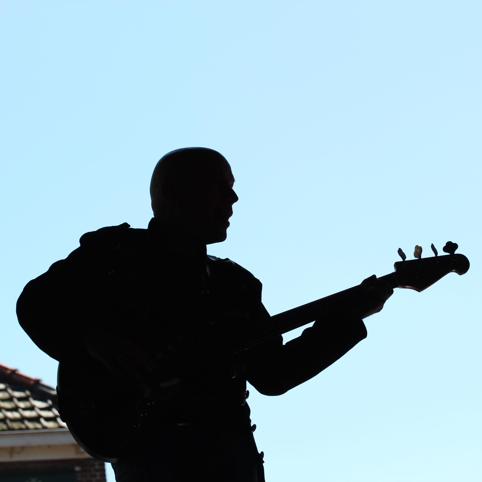 Bass player by Henk de Groot