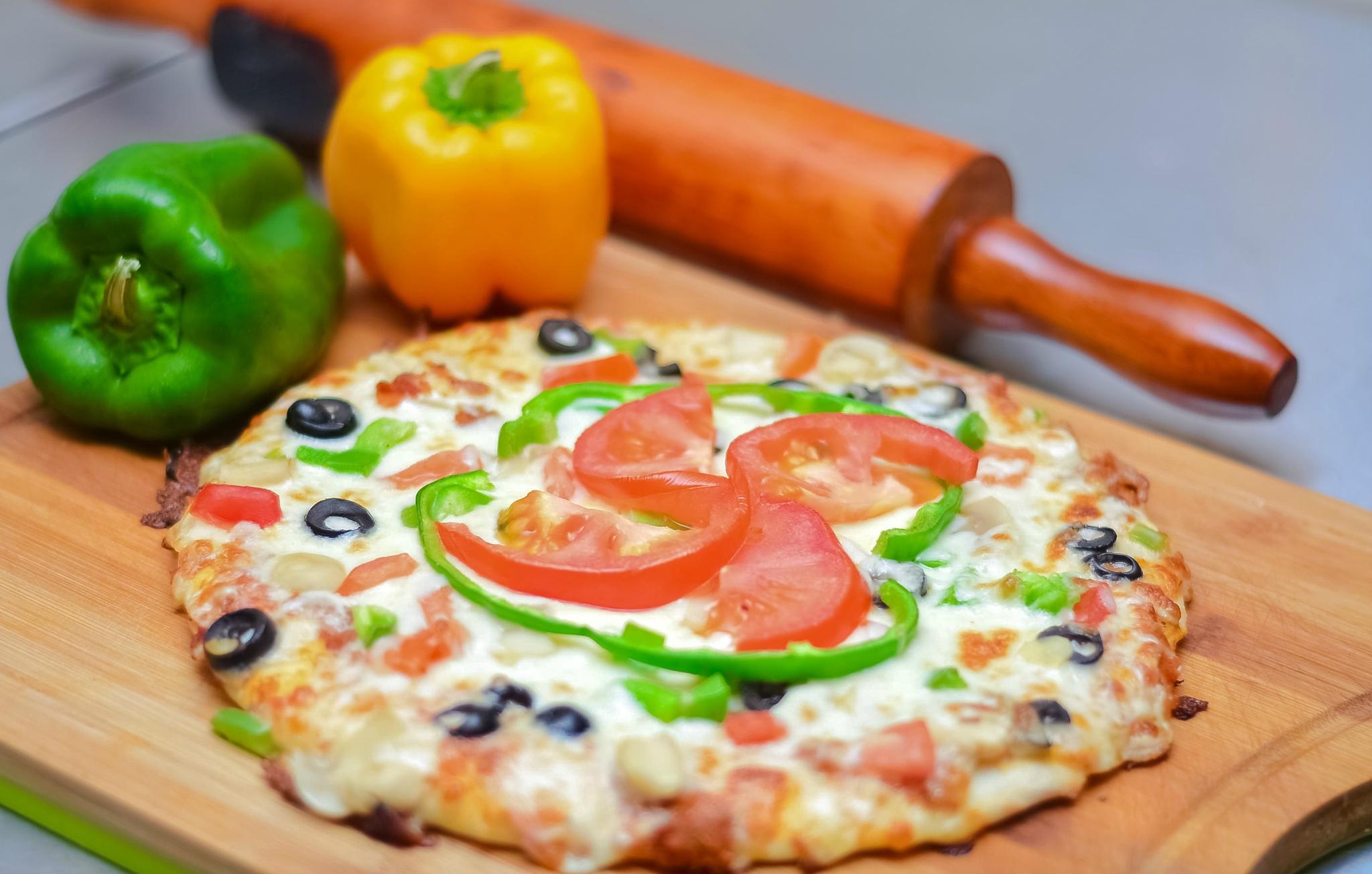 Pizza  by Nabeel Madarati
