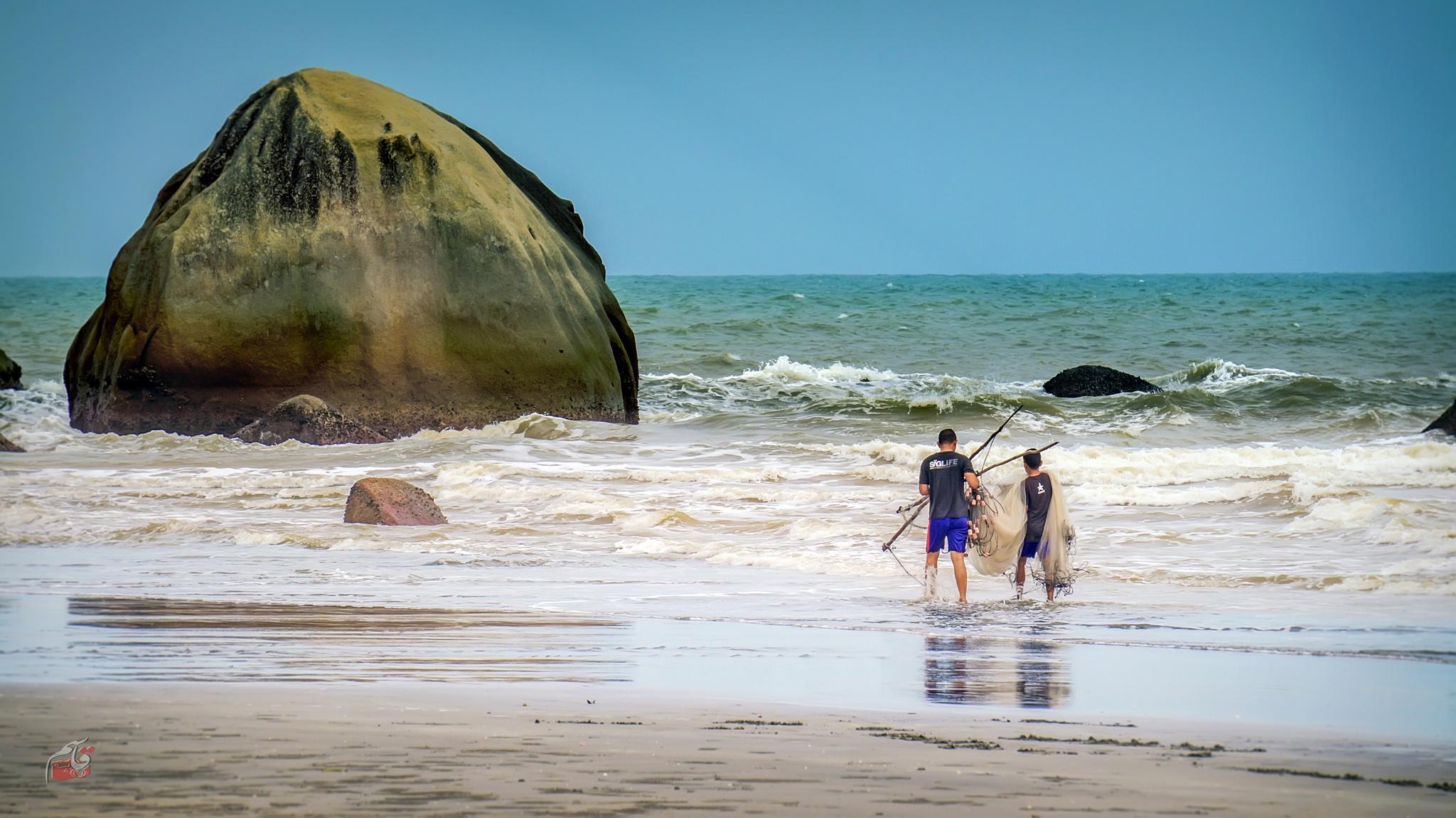 fishing on the beach by Qasem El Akhdar