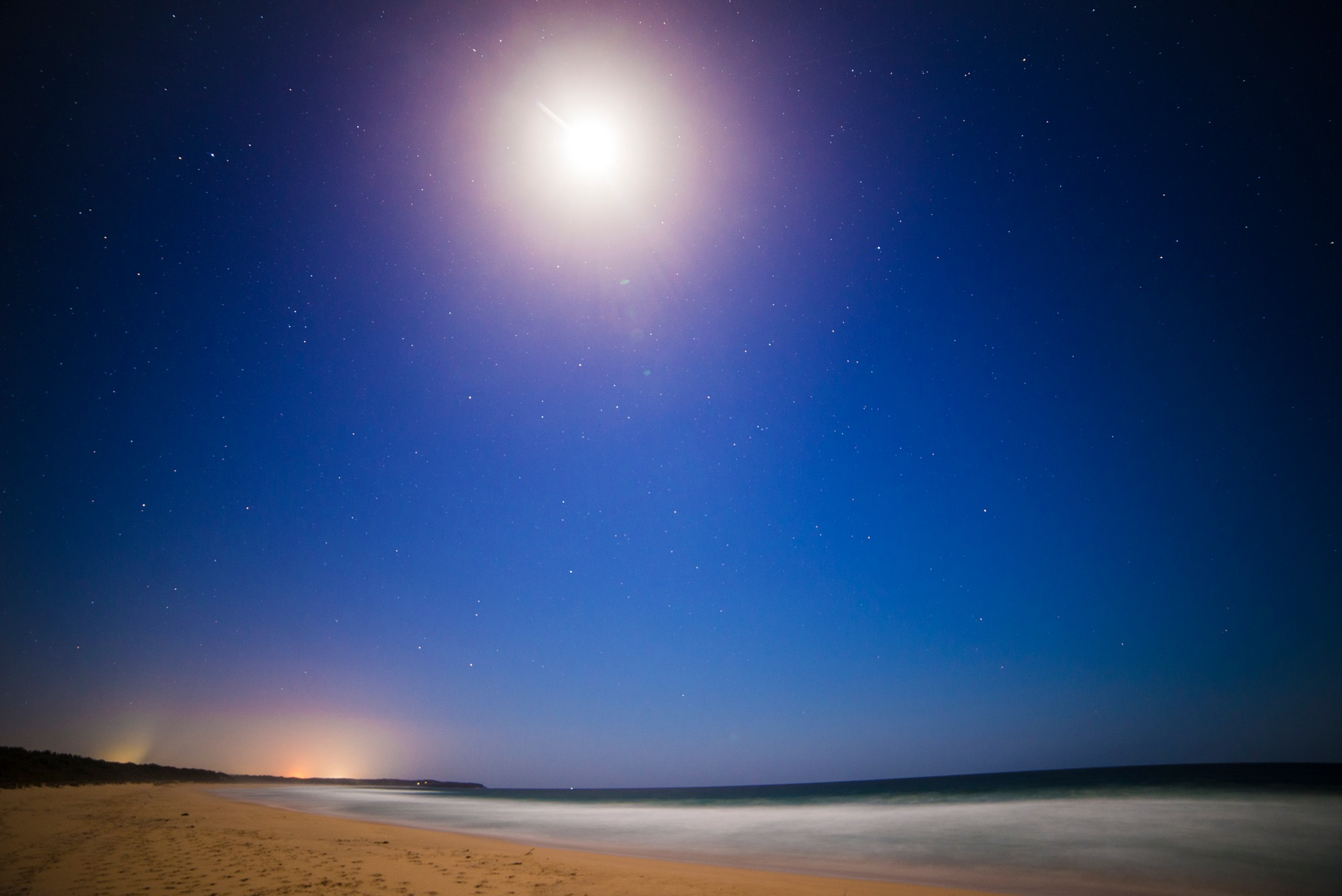 Wairo Beach with Moon in Shot by Graham Levi