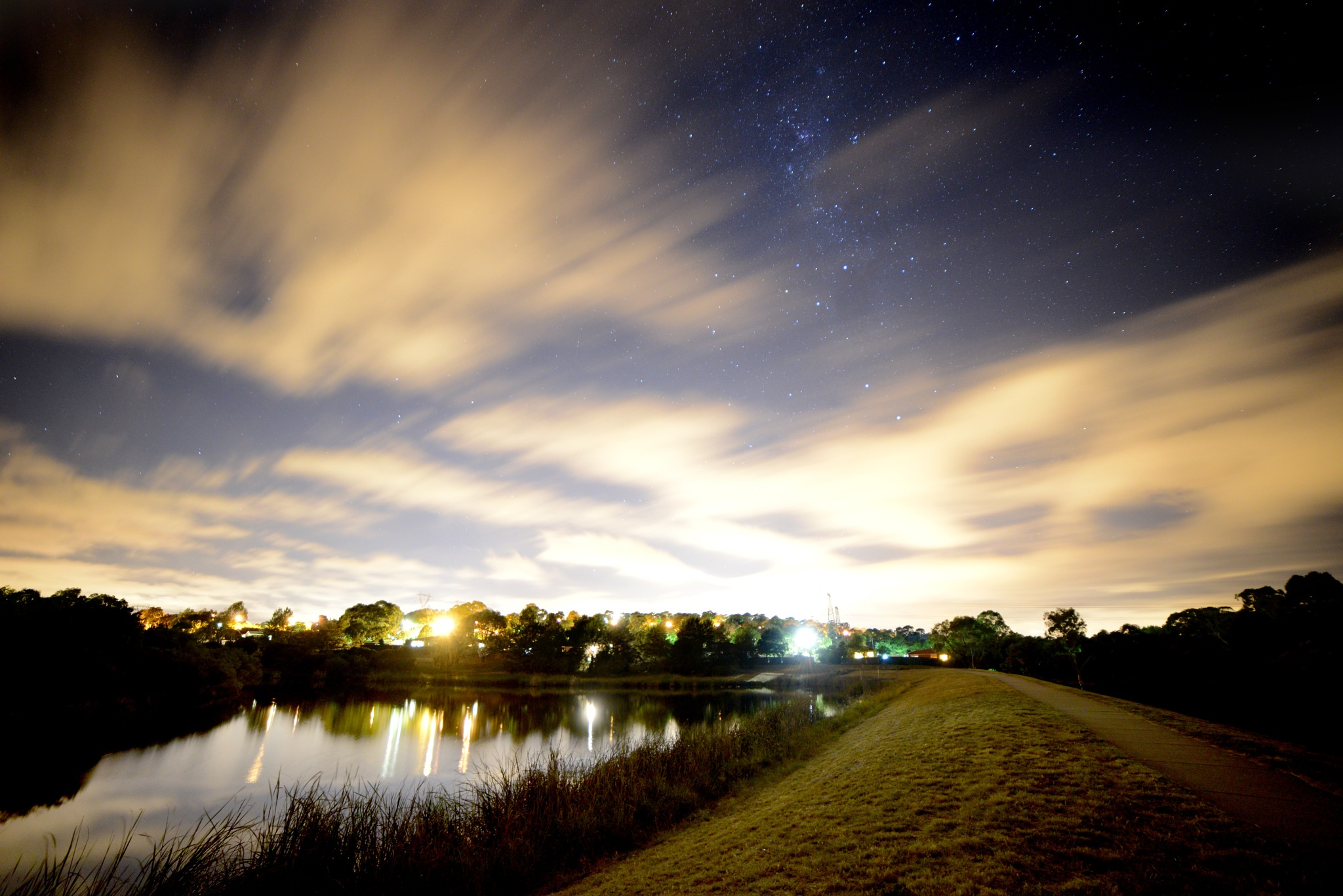 Fassifern Pond at Night with Stars and Clouds by Graham Levi