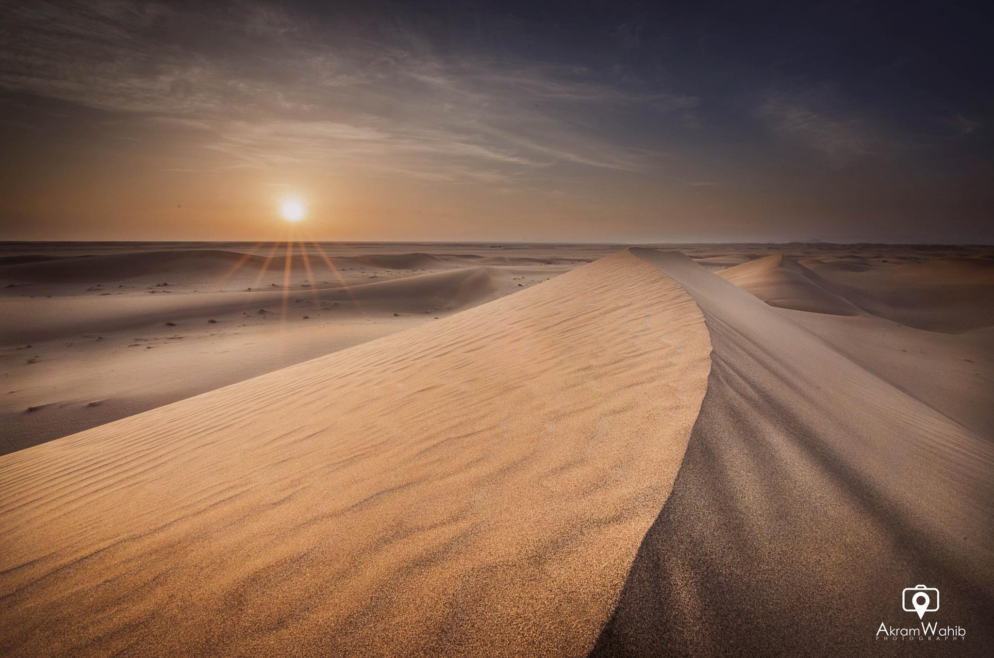 Sunset in Desert by Akram Wahib