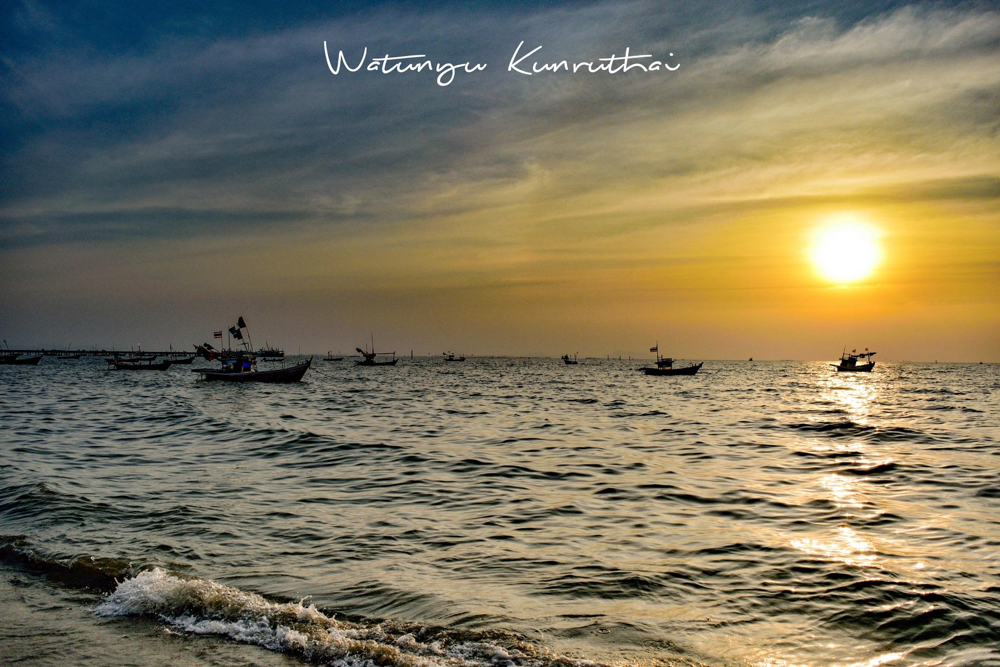 sunset at the beach  by Watunyu Kunruthai