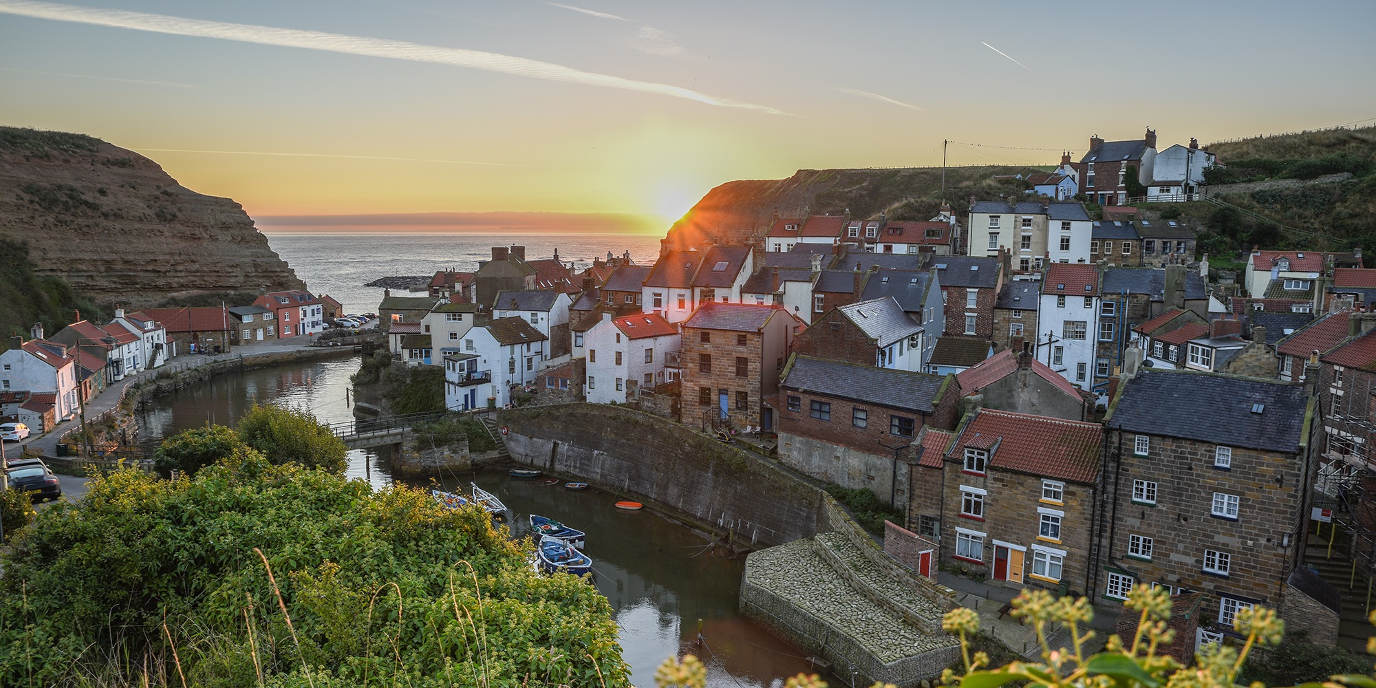 Sunrise at Staithes by jonkennard