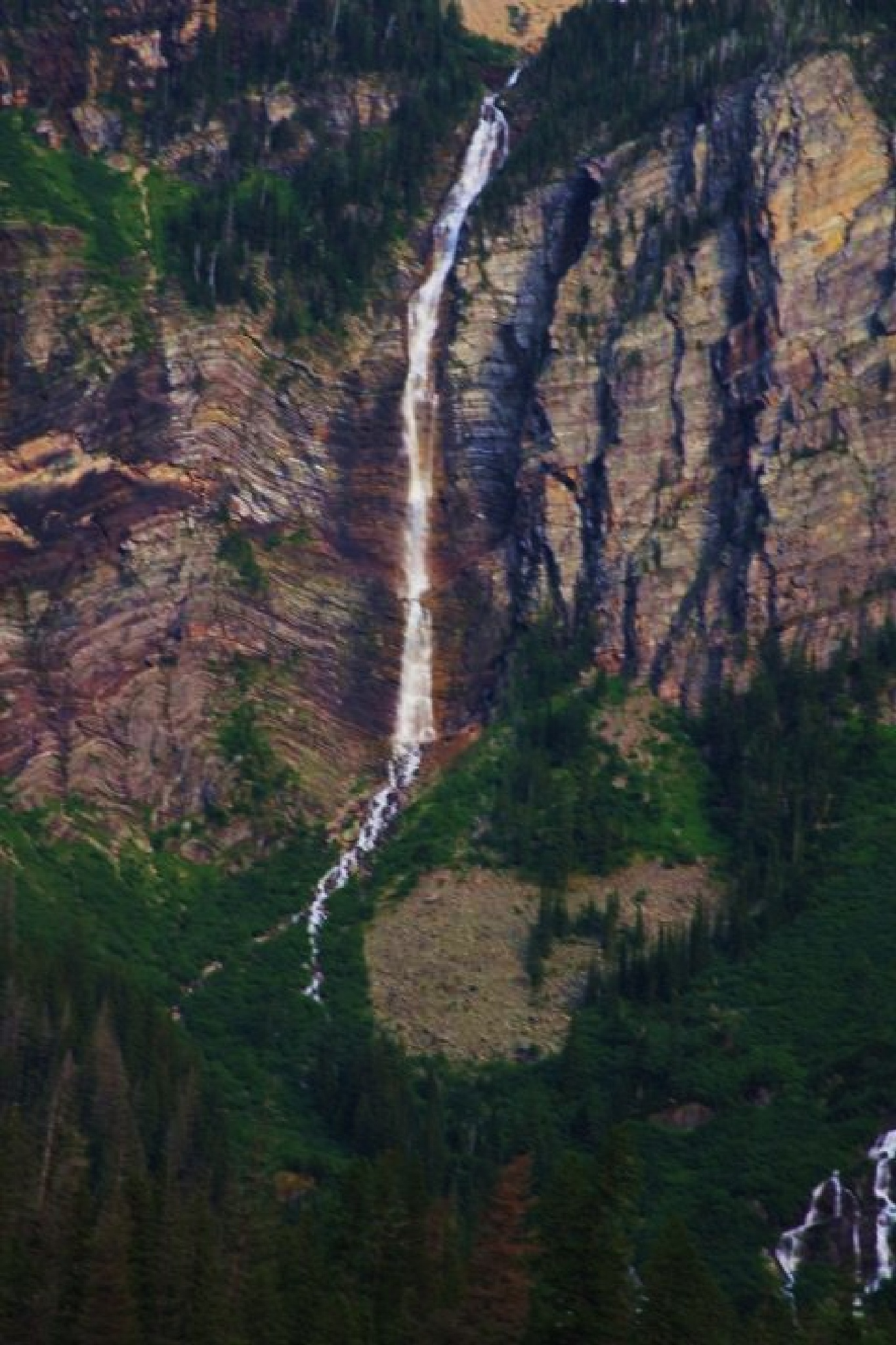 Another unnamed water fall at Glacier NP by  Houston Photography Studio