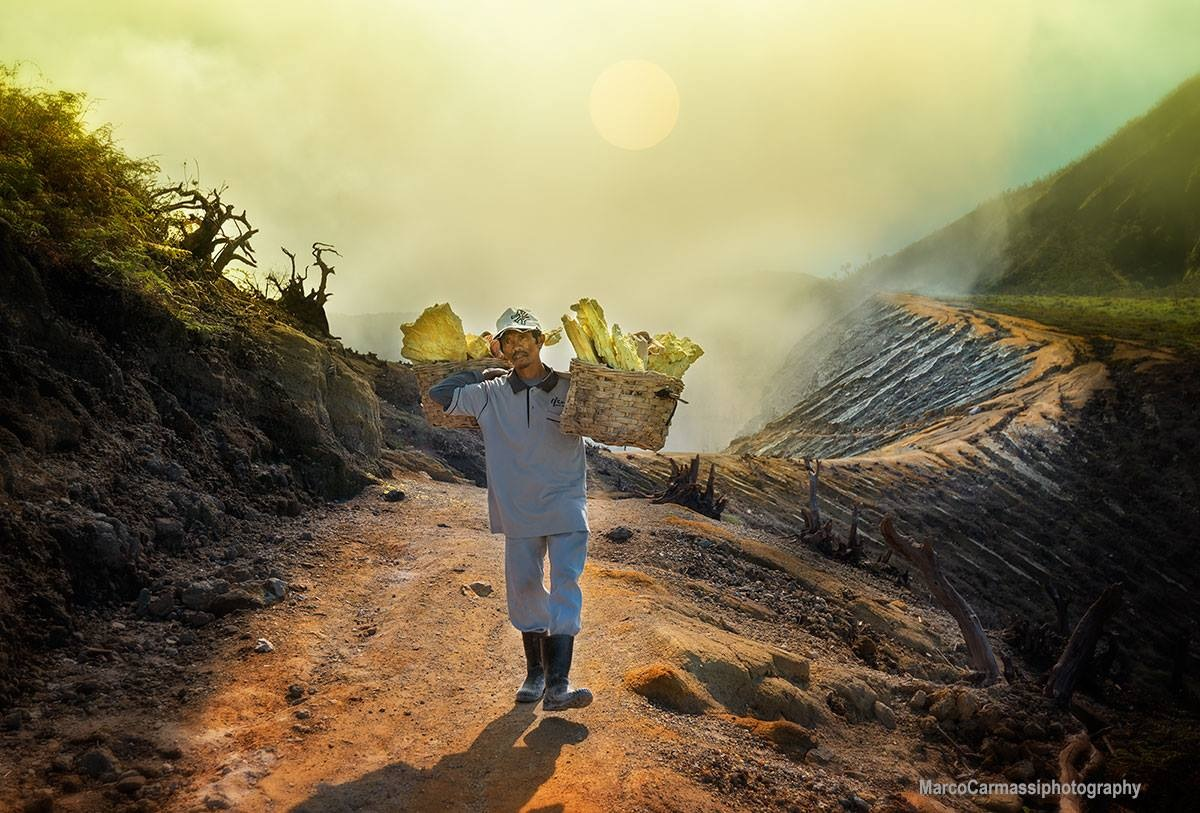 Man passing by a volcano by marco_carmassi