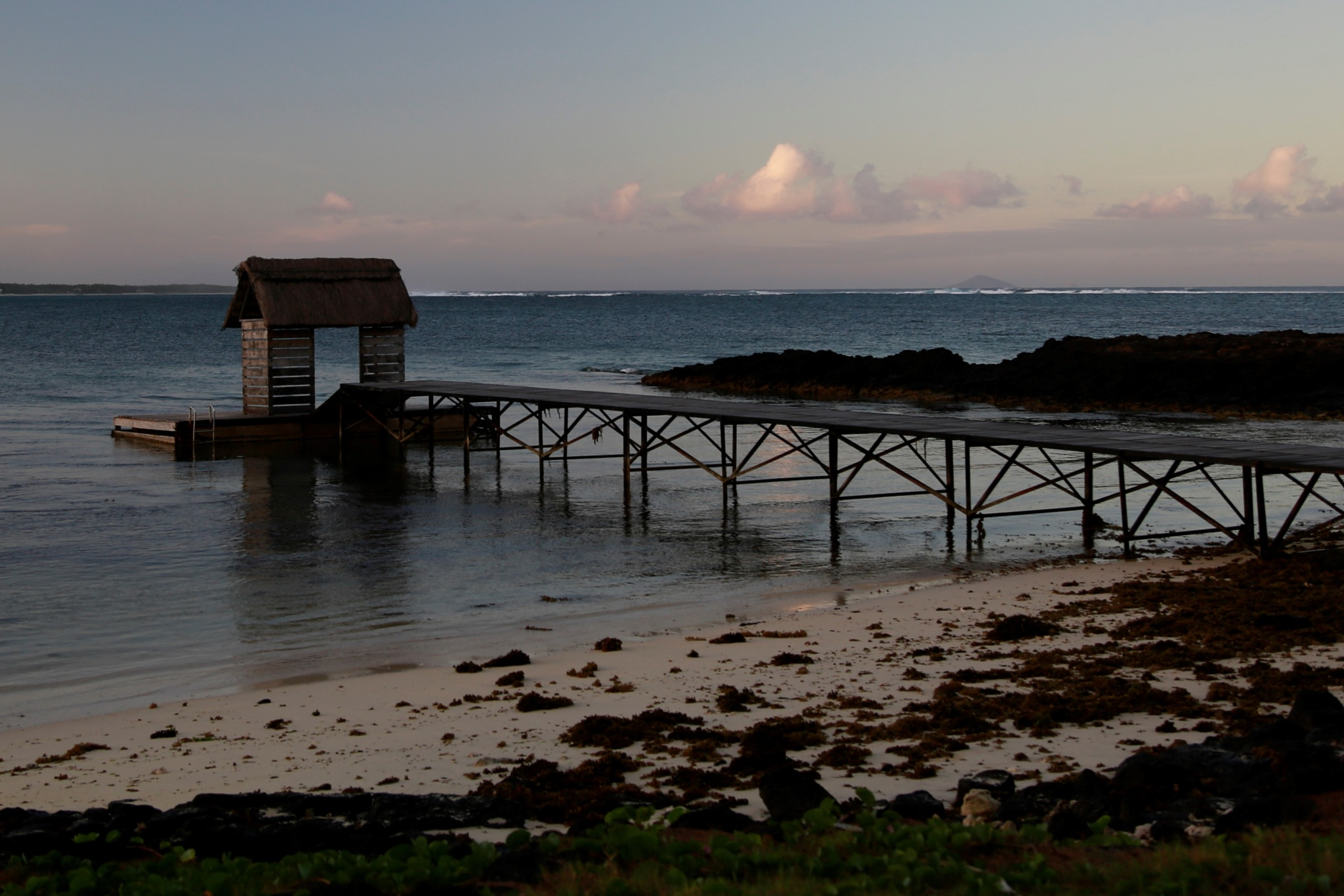 Sunrise over the boathouse by Debbie Engelbrecht