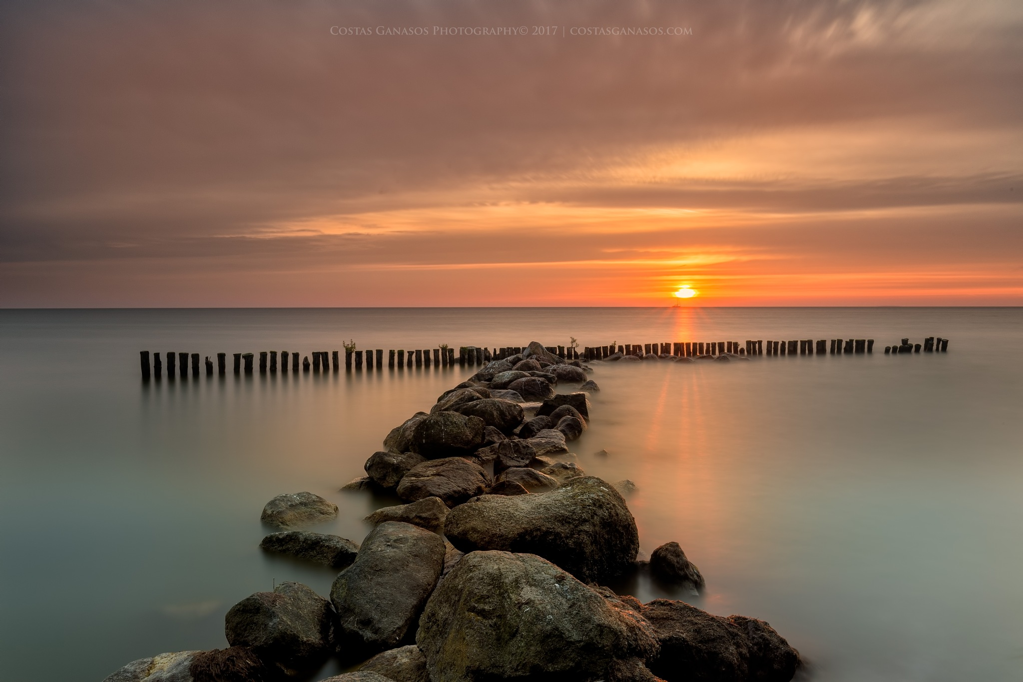 Sunrise by the shore of Enkhuizen by CostasGanasos