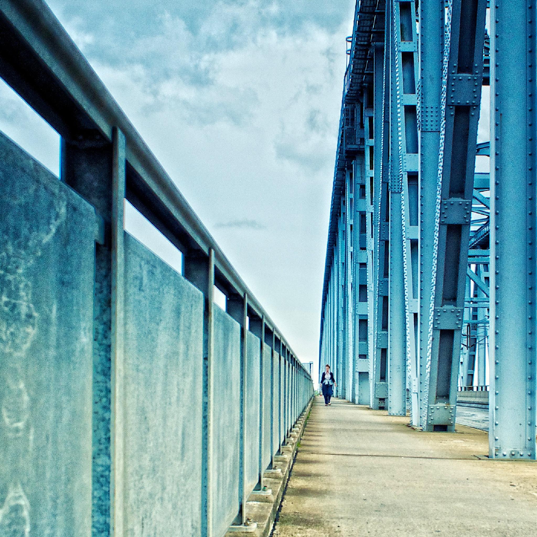Pedestrian on the old bridge. by Tue Romanow