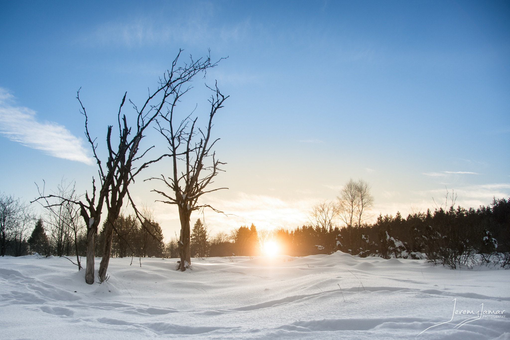Sunset in a sea of snow by Jeremy Jamar