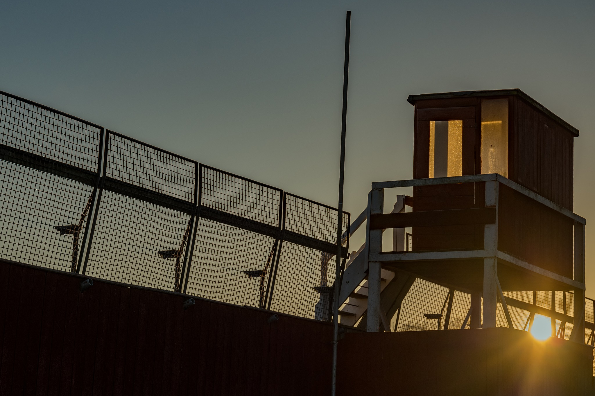 Winter sun Rising over Grandstand by mike hughes