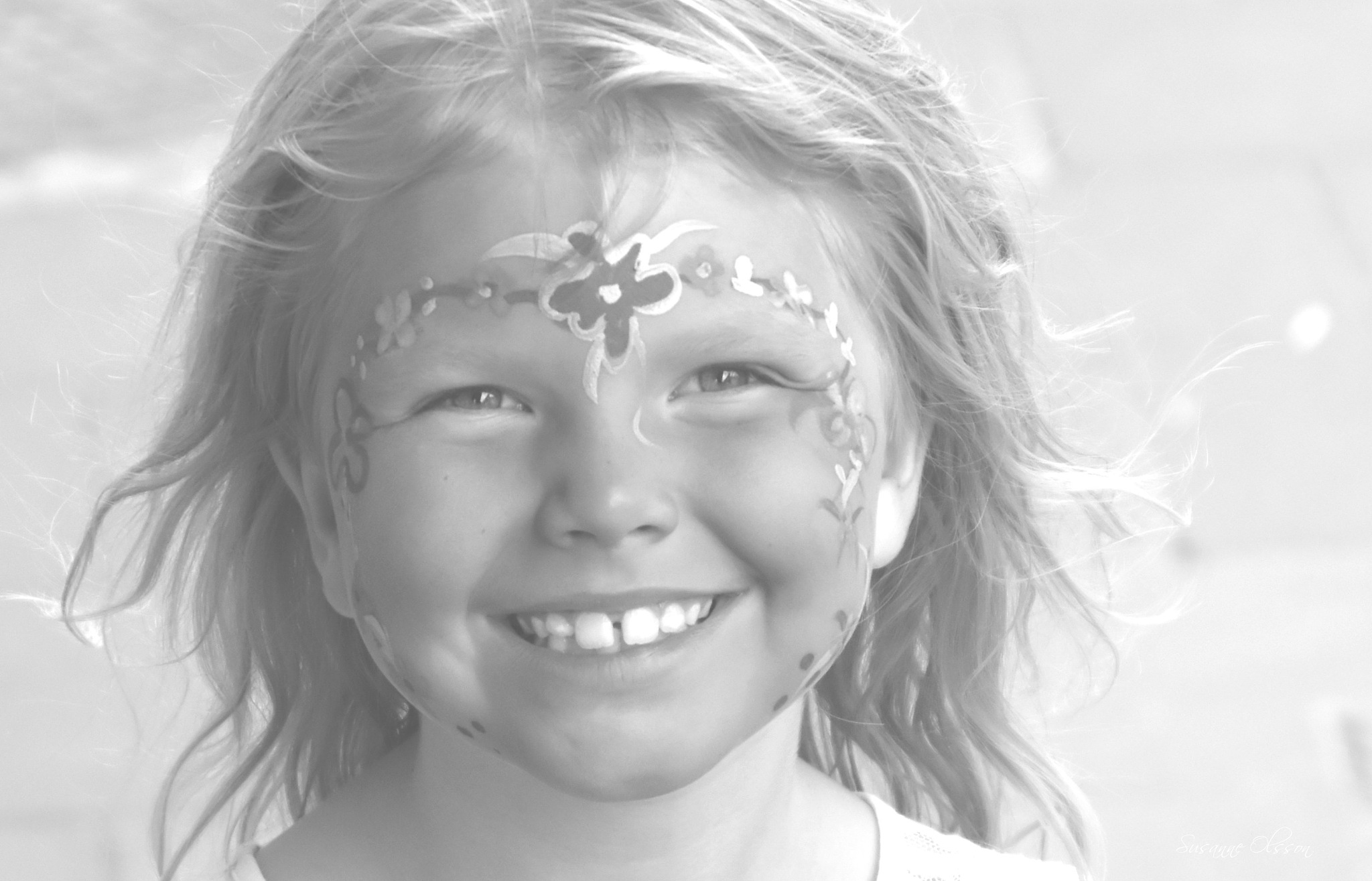 Face painted girl by Susanne Olsson