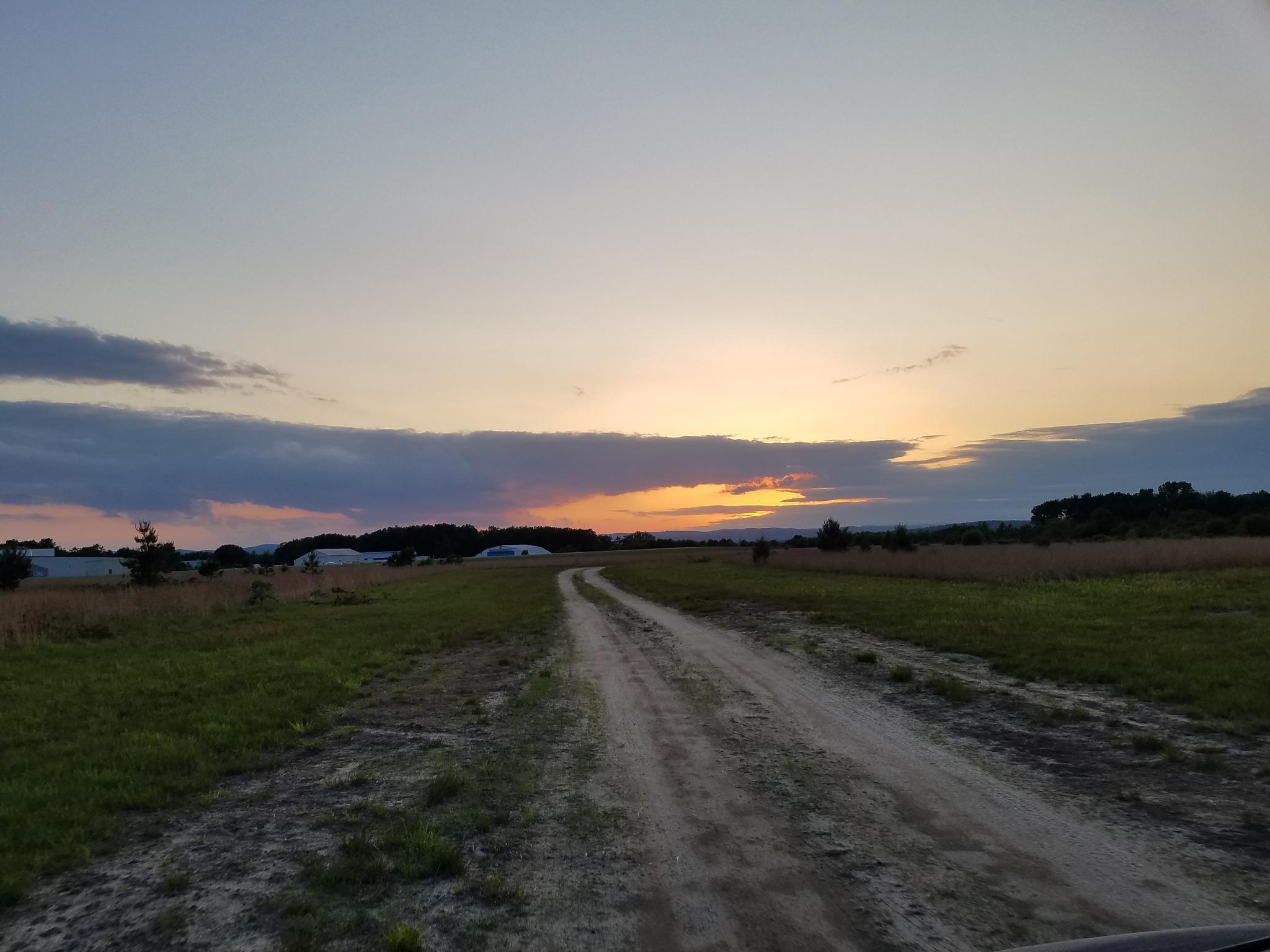lonely road at dusk by David Korpiewski