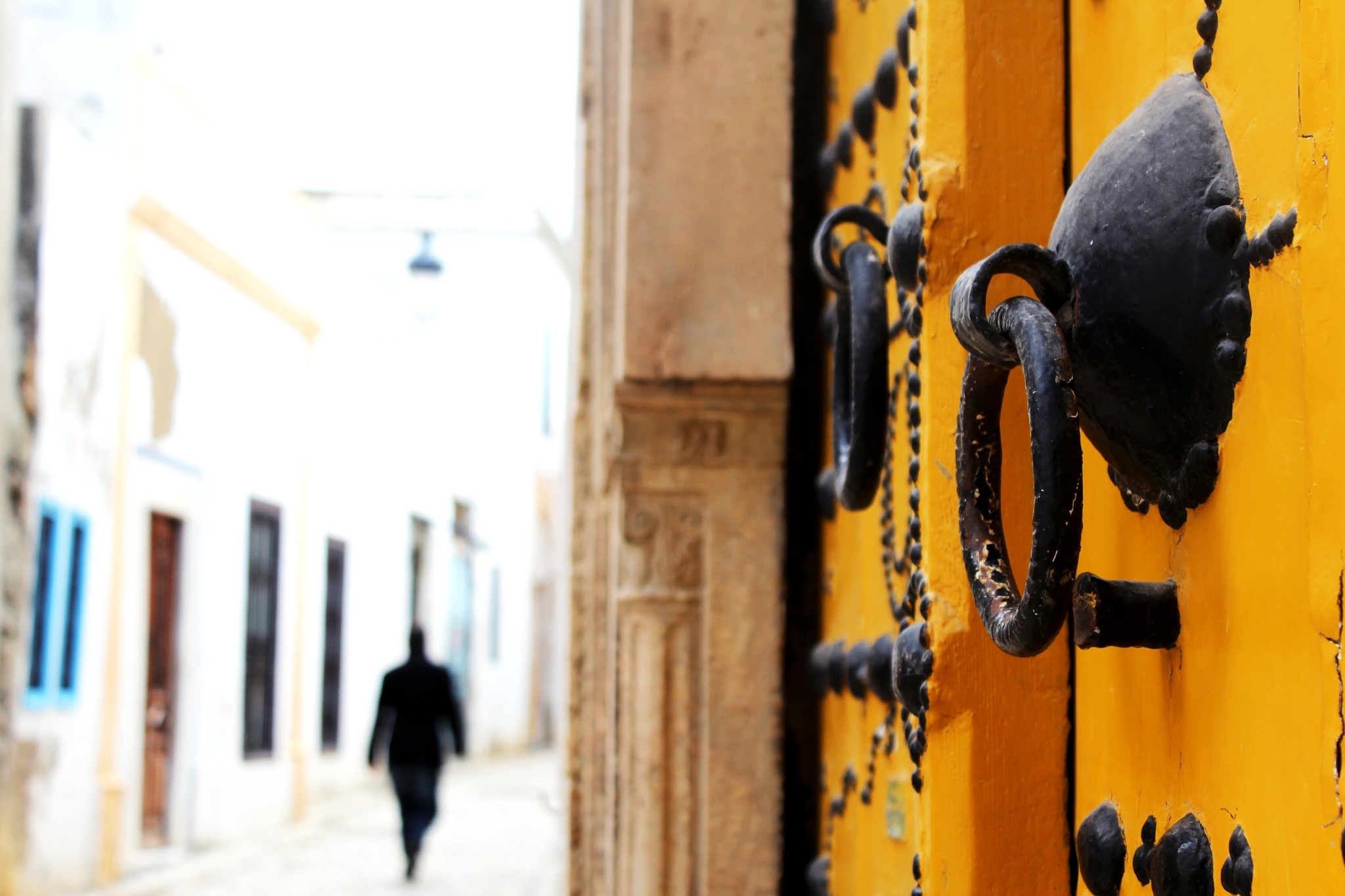 Photo in Architecture #doors #door #yellow #knock #black #man #street #peace #tunisia