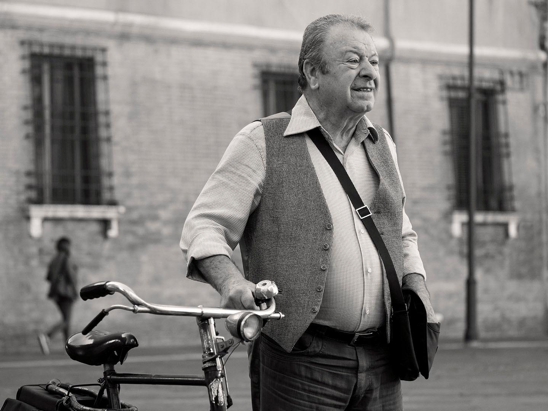 Man with bicycle by nnudekim
