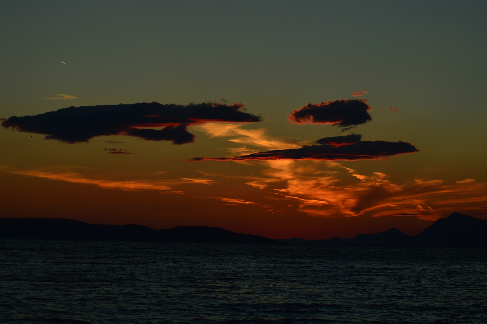 sunset over the sea by KaSab