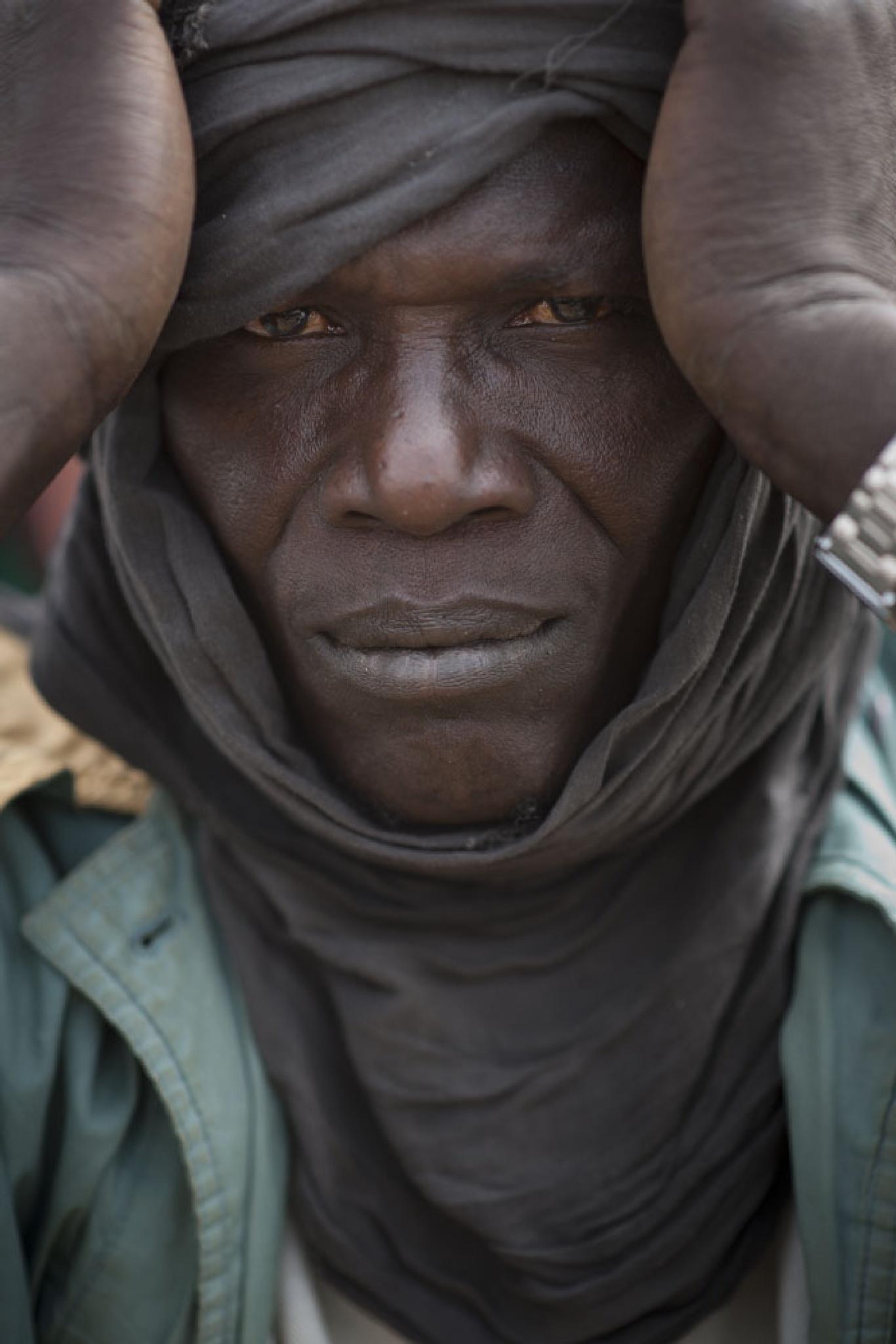 Fisherman, Mali by Martin Hartley