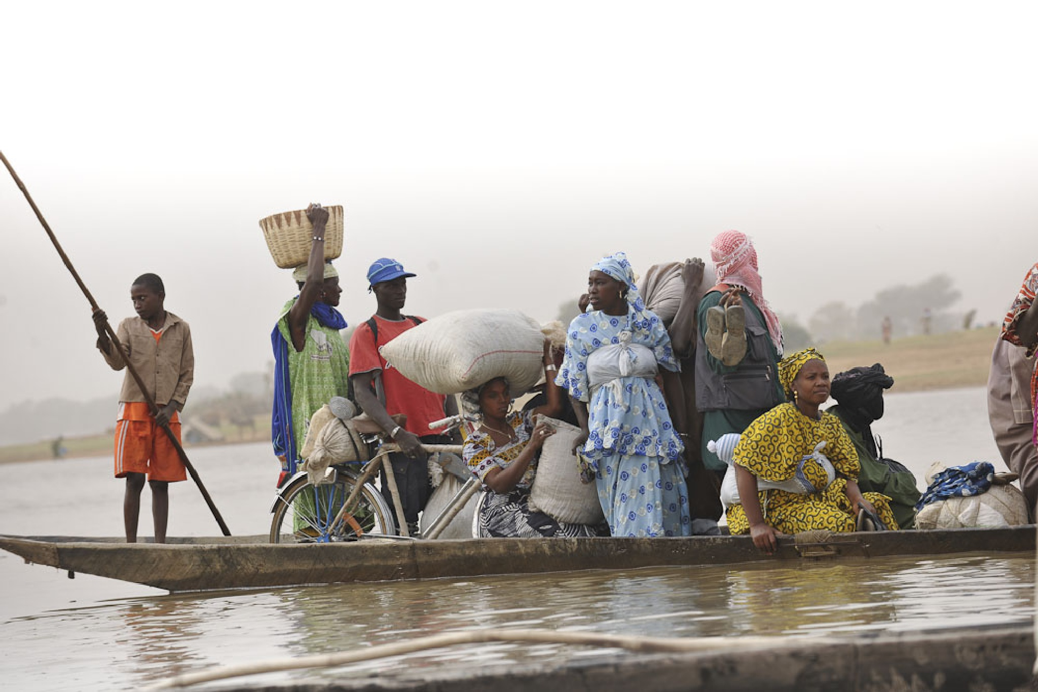 Bus home after shopping trip, River Niger, Mali by Martin Hartley