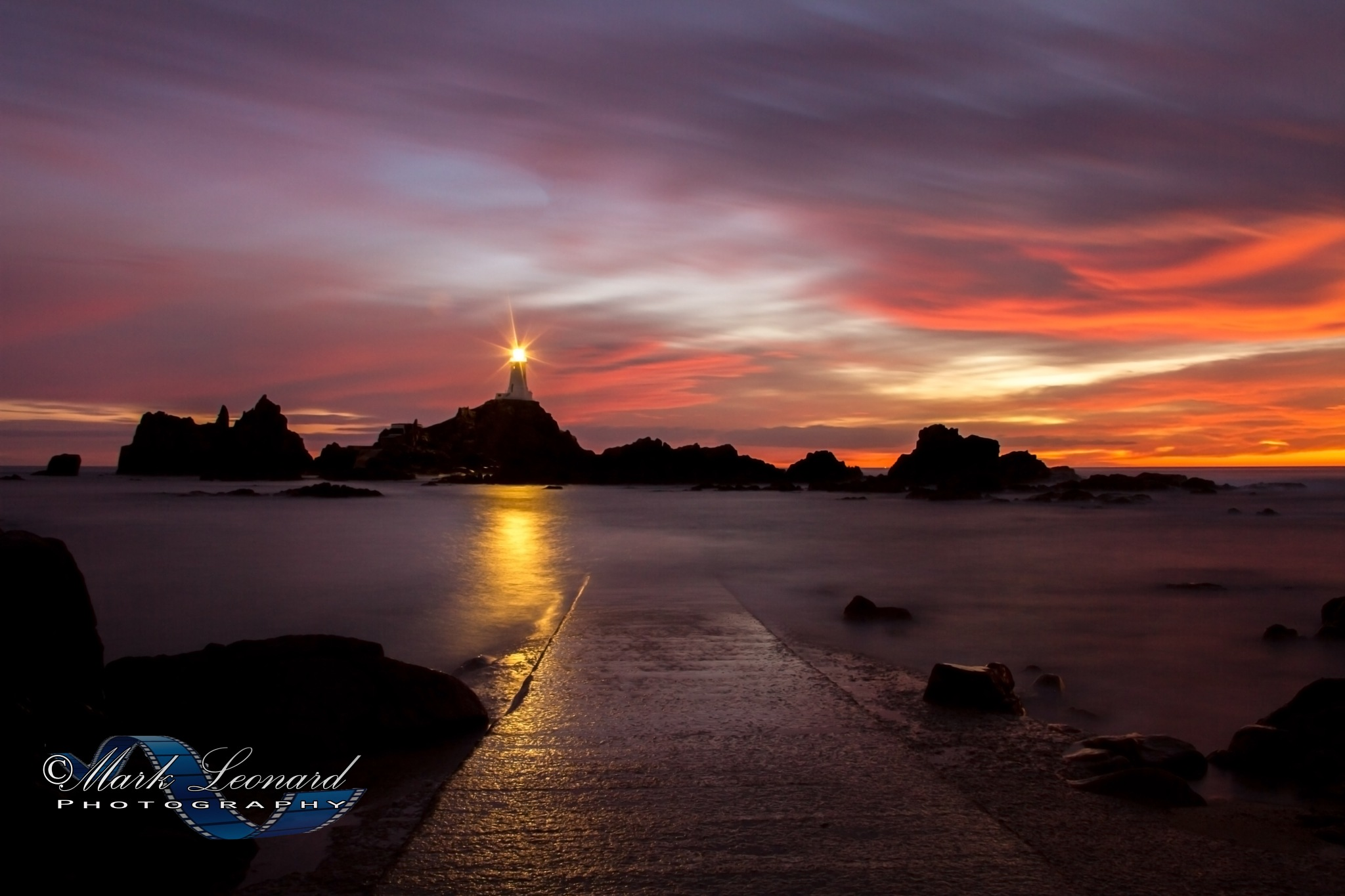 Corbiere Lighthouse, Sunset. Jersey by Mark Leonard