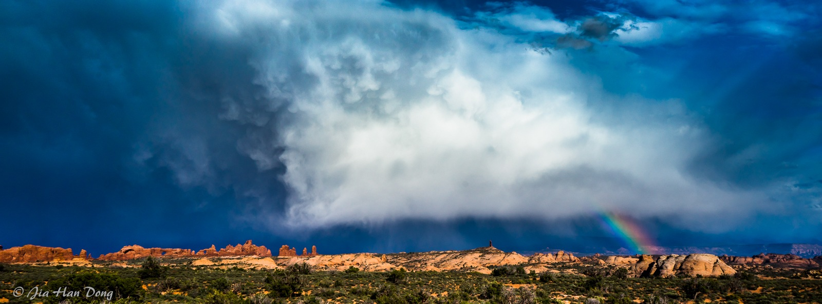 Rainbow, stormy clouds, Arch National Park by Jiahan Dong
