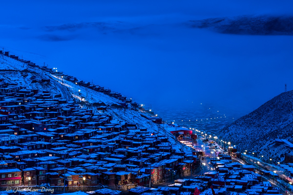 Snow covered Larung Tibetan Buddhist Academy  by Jiahan Dong