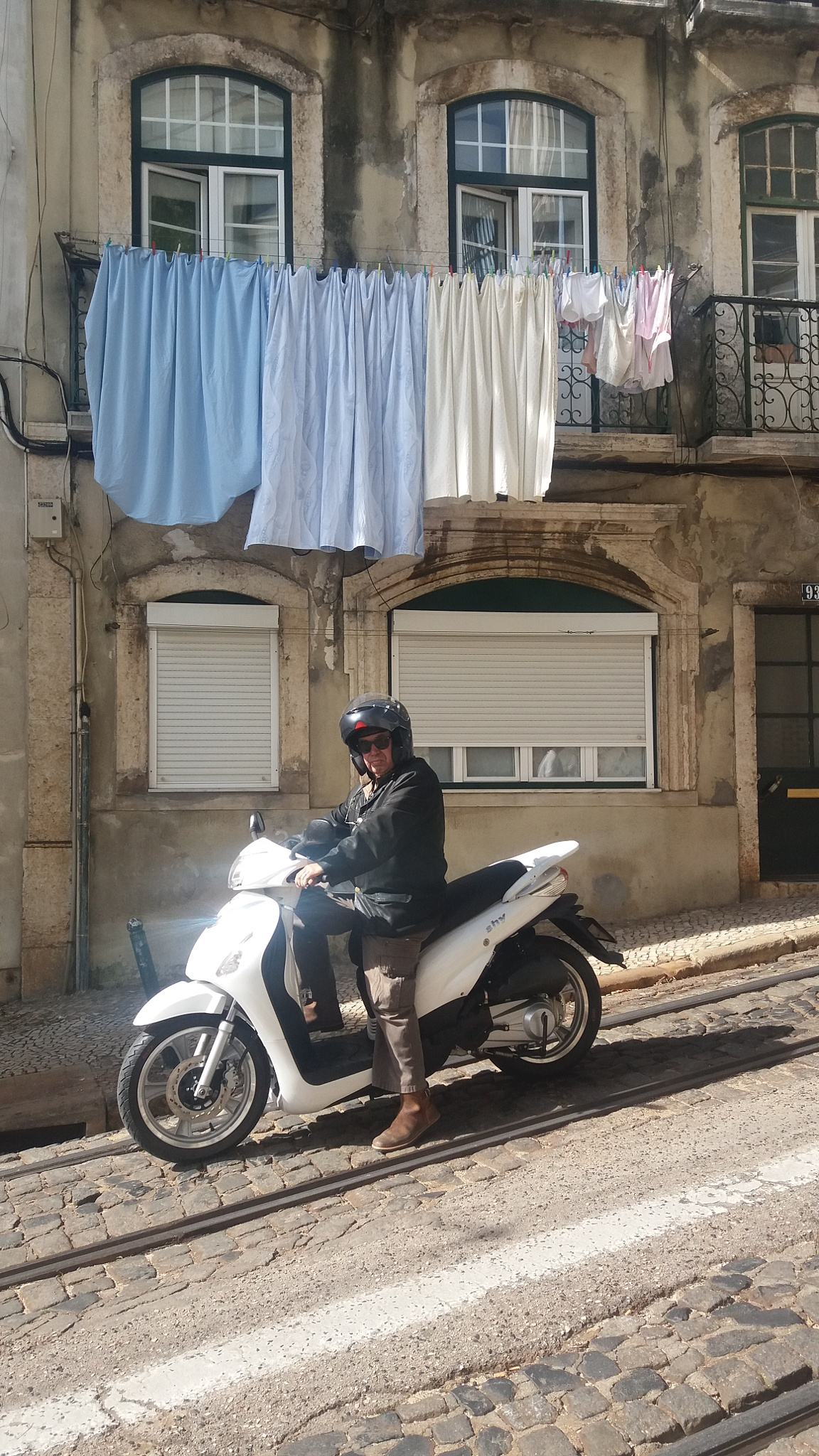 Motorbike man at the traffic lights by Nea Lo