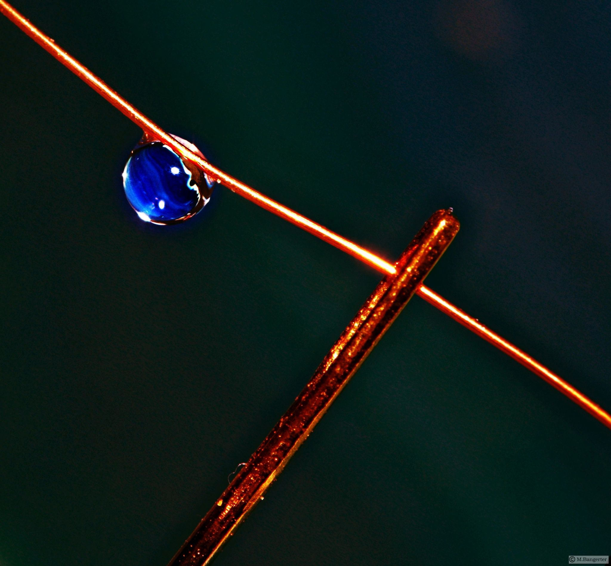 Blue drop and needle's eye by Michael