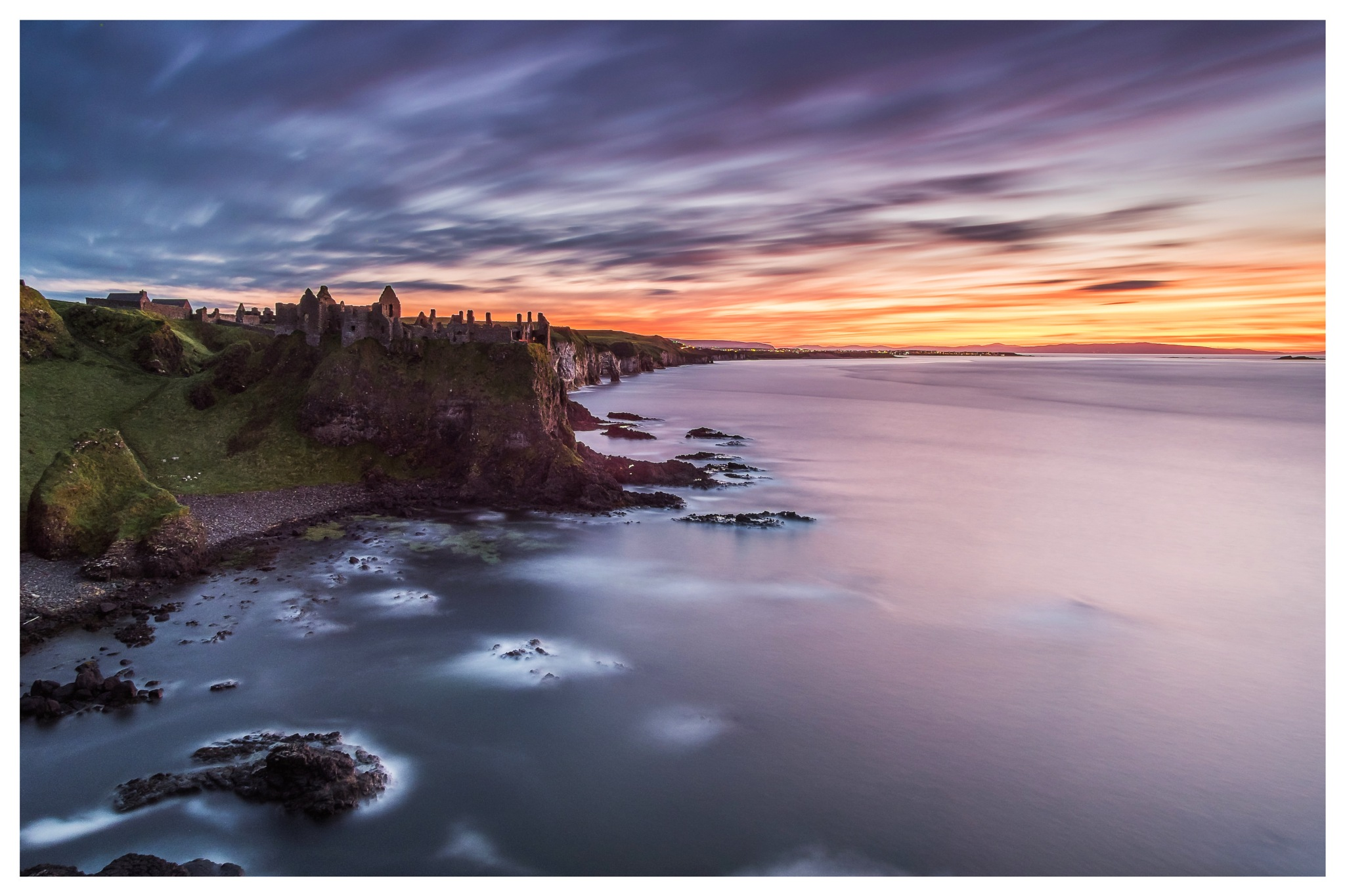 Dunluce castle sunset  by Lee Morrow