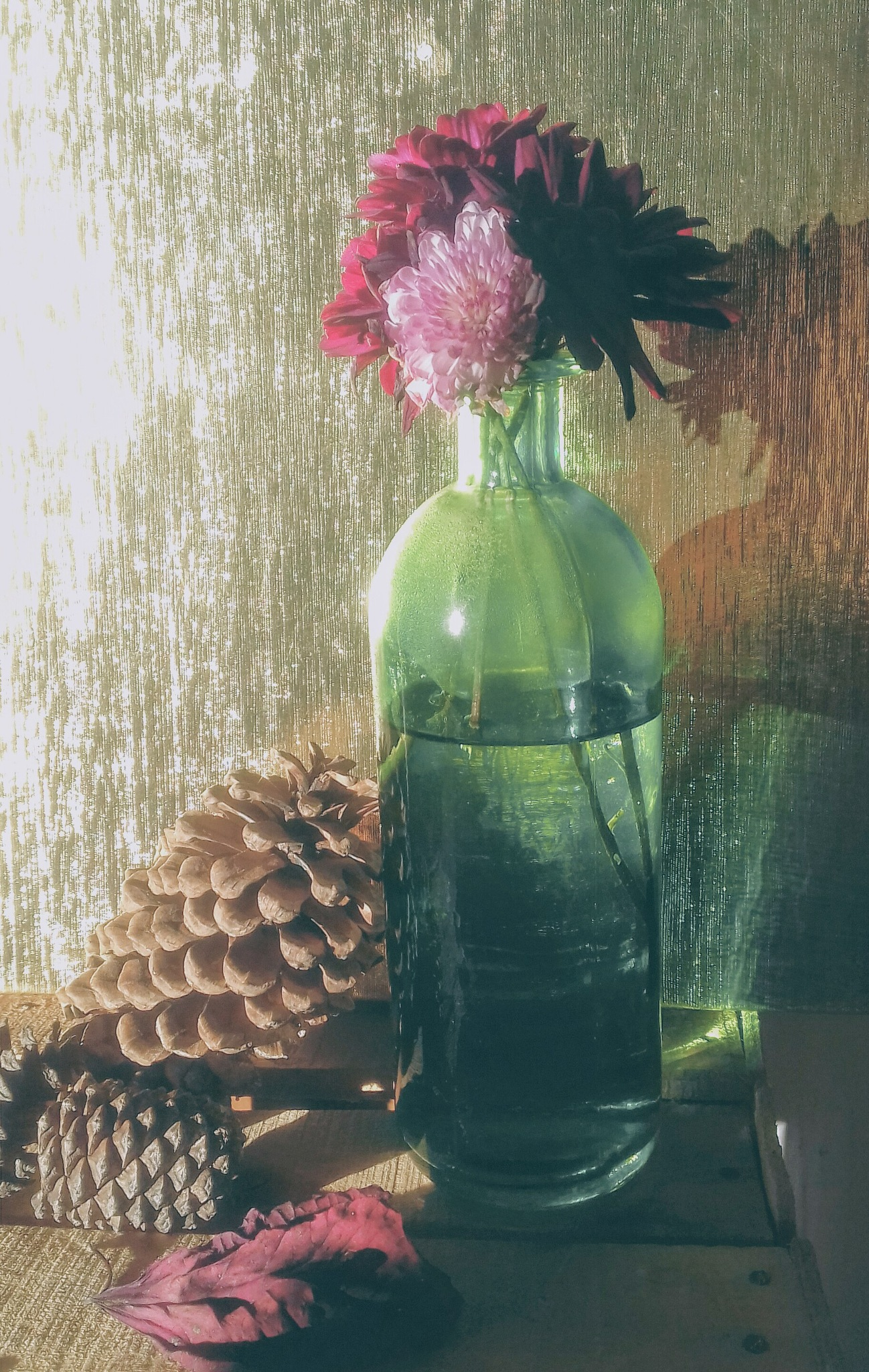 Photo in Still Life #bottle #pinecone #flowers
