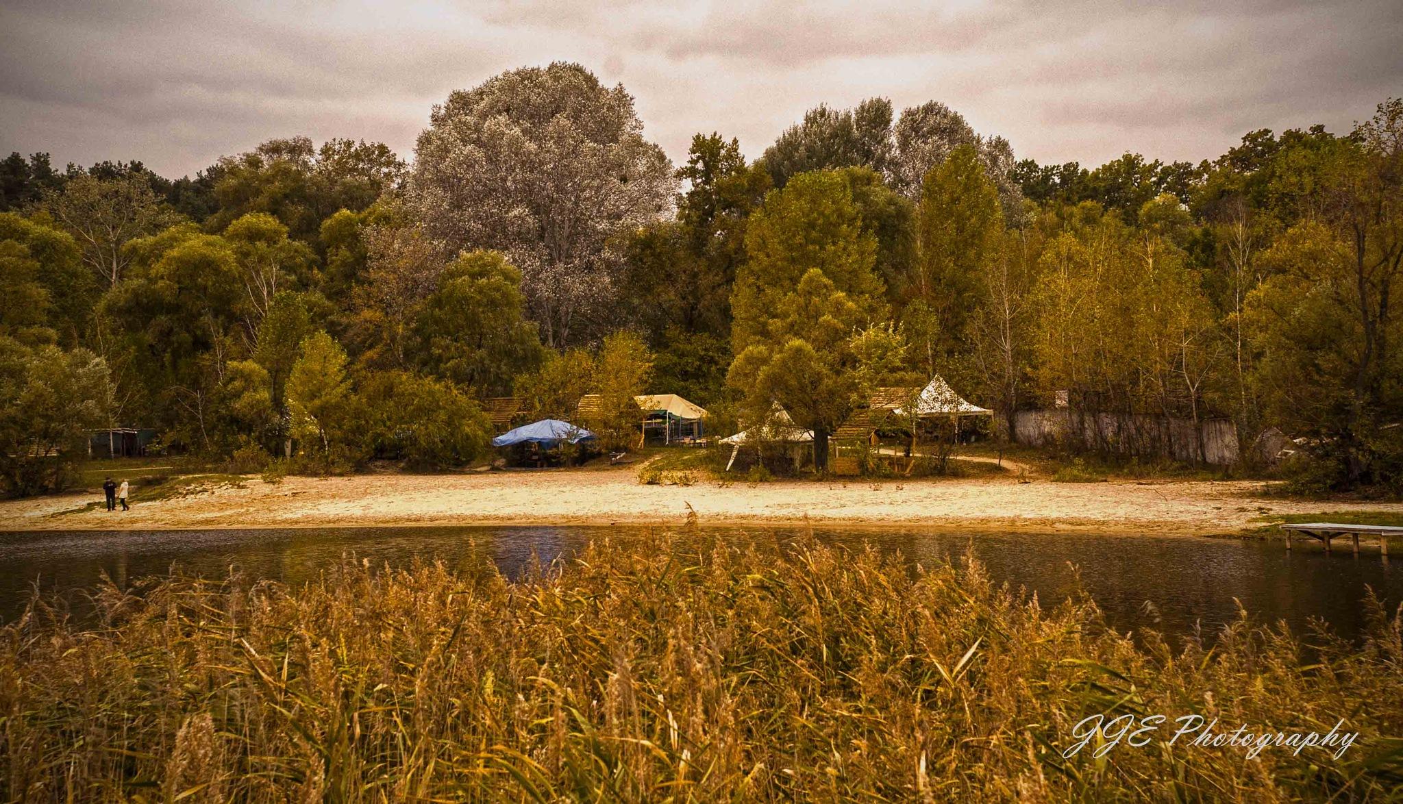 Across the lake in Autumn by jassaj