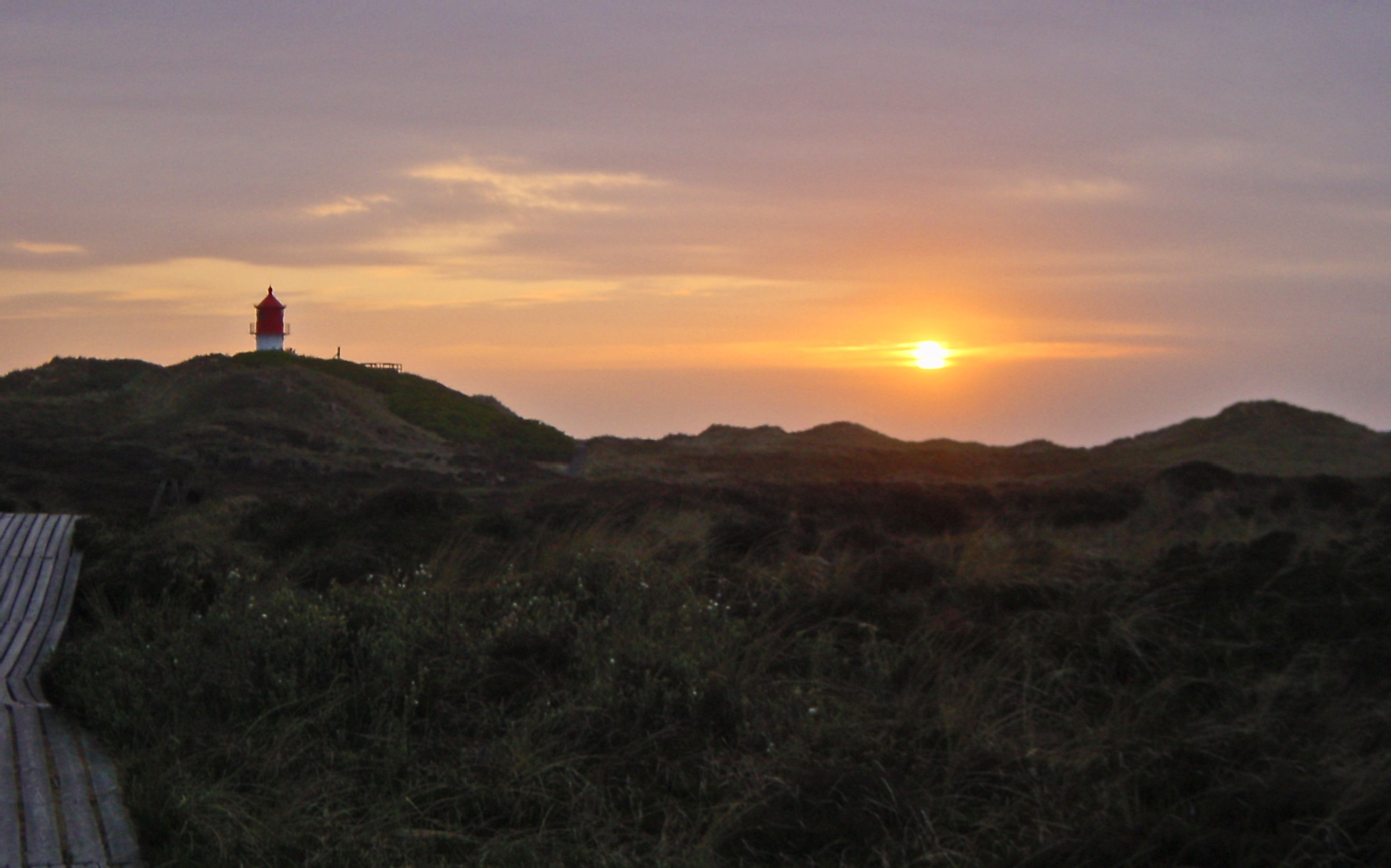 Sunset at Amrum Lighthouse by dirtyharriet