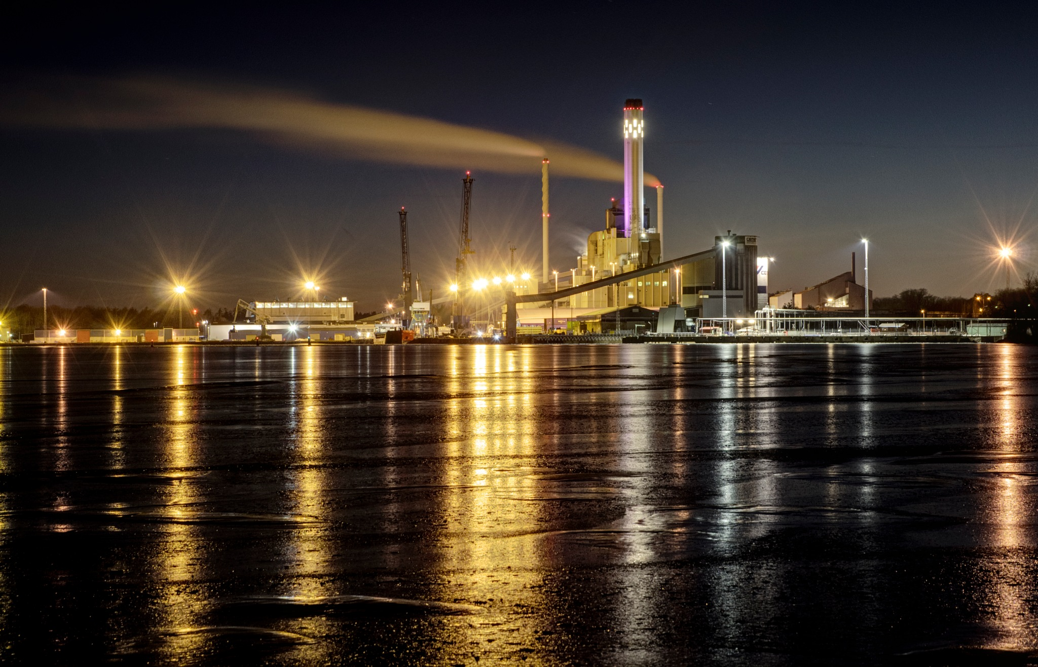 Thermal power station by night by Alexander Arntsen