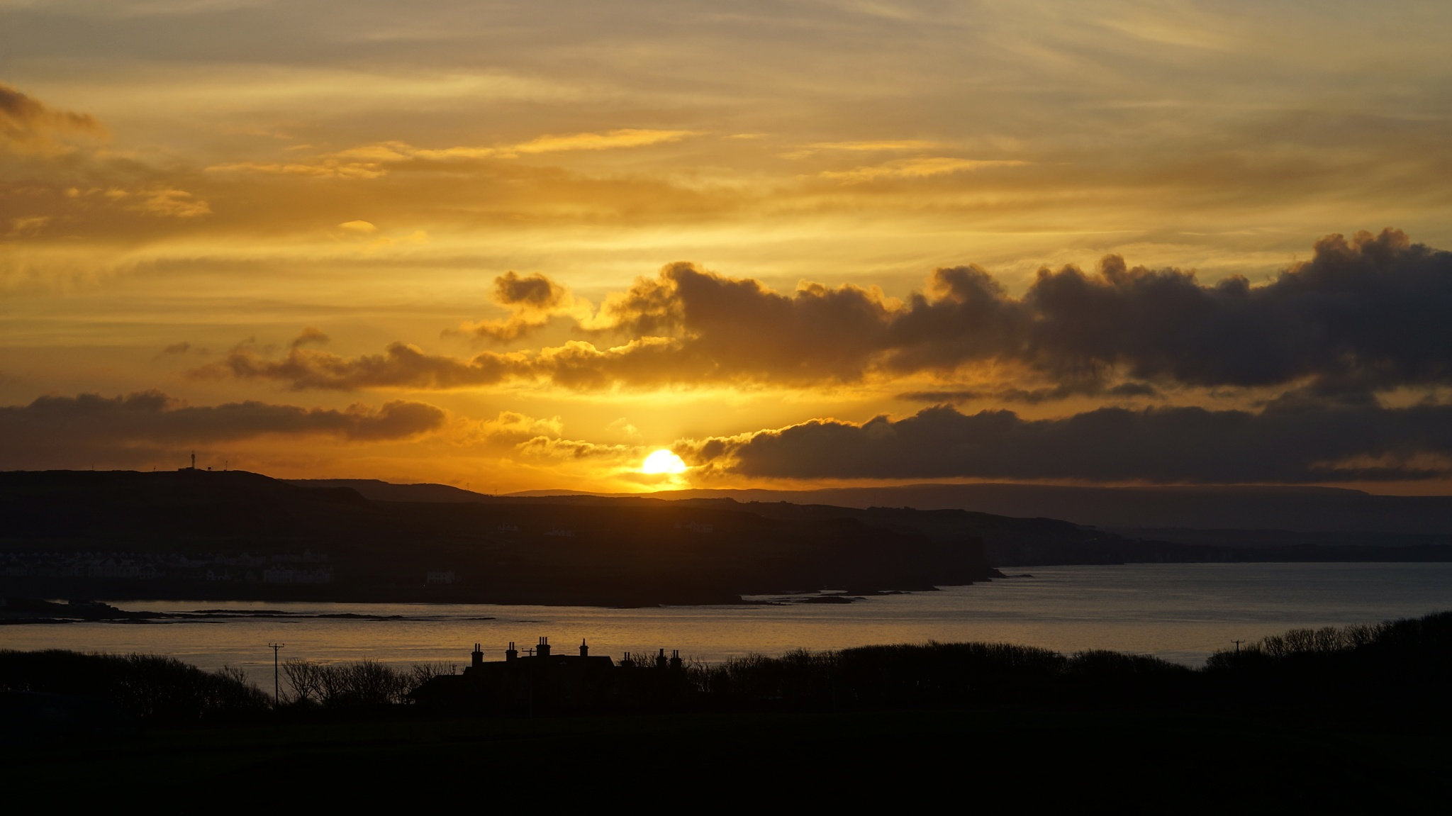 Sun Down over the land of Finn McCool by Andy Lake