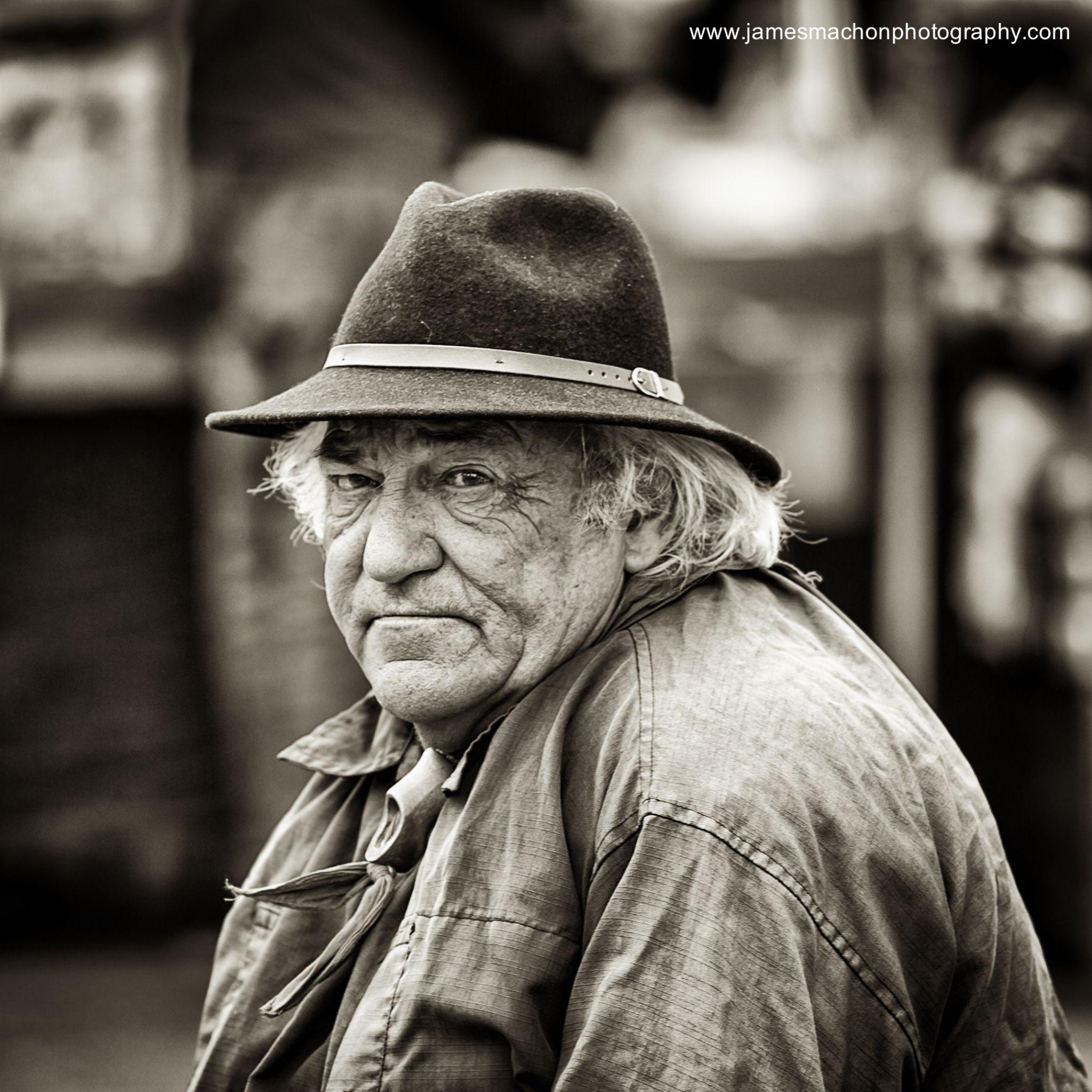 Market Trader by James Machon Photography