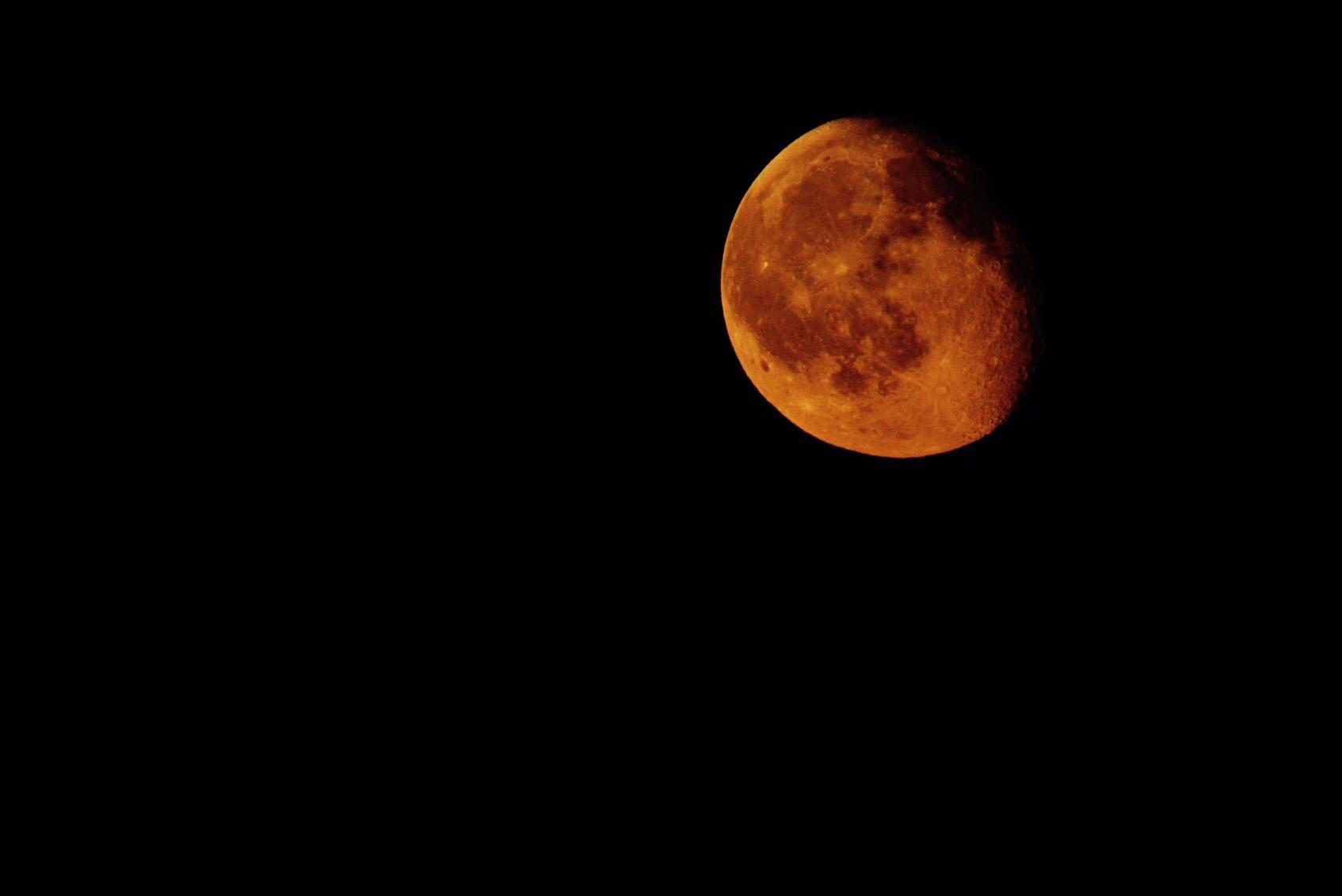 Red moon by Andrea Battistoni