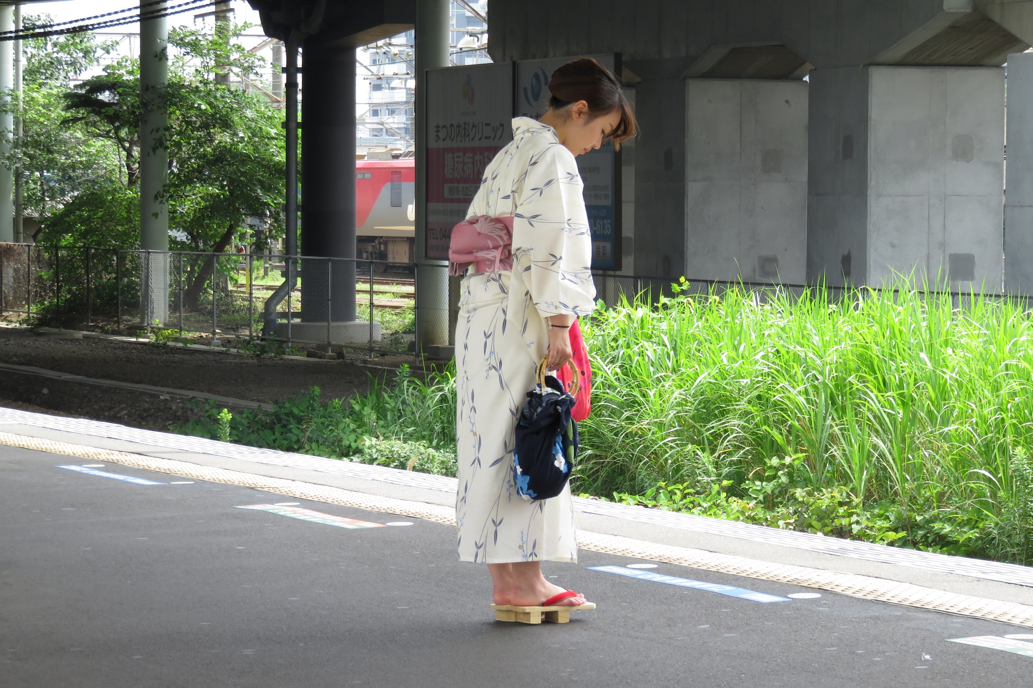 Japanese woman waiting by Mat Manes