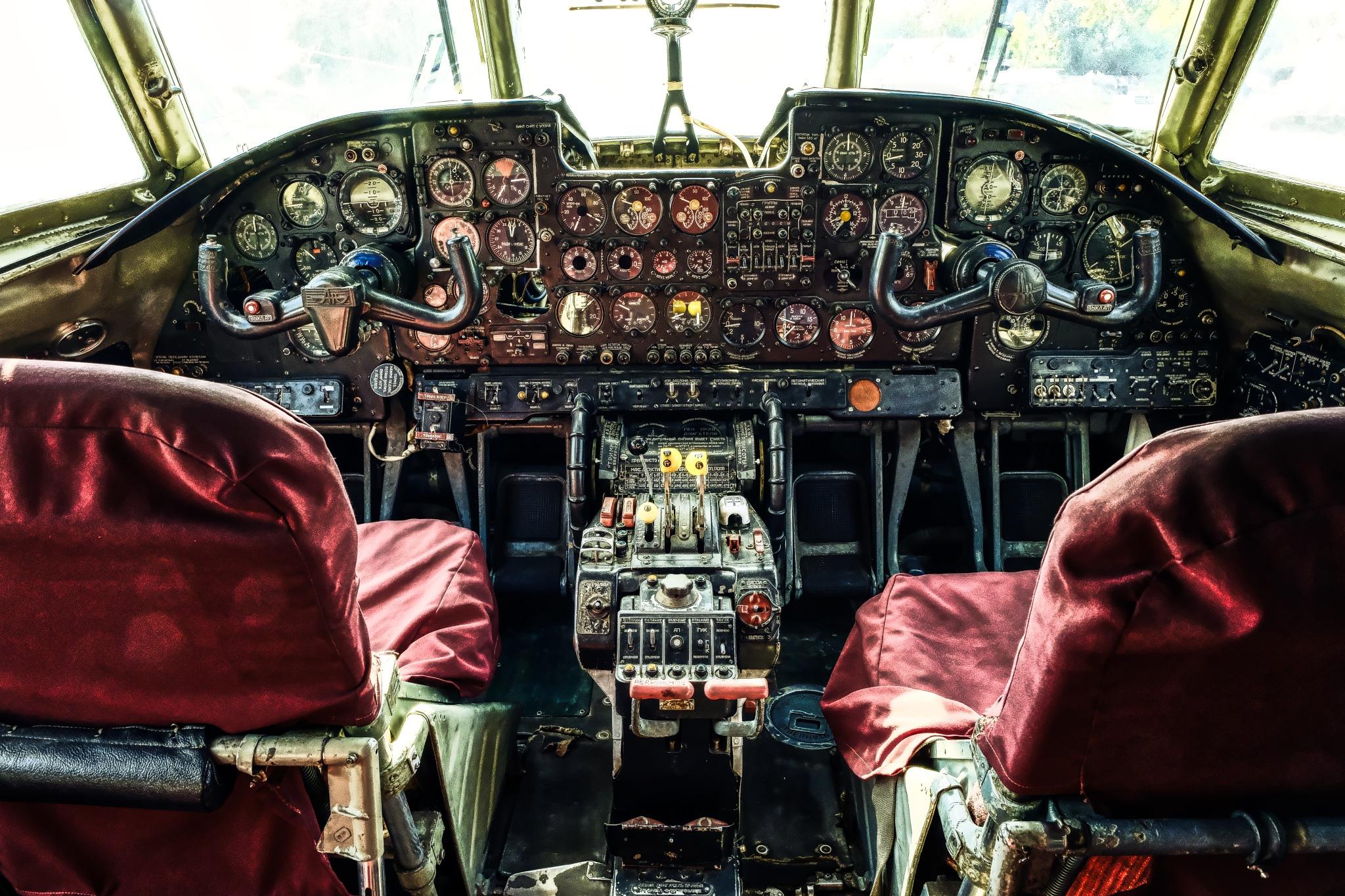 In cockpit of old Russian war plane  by Goran Jorganovich
